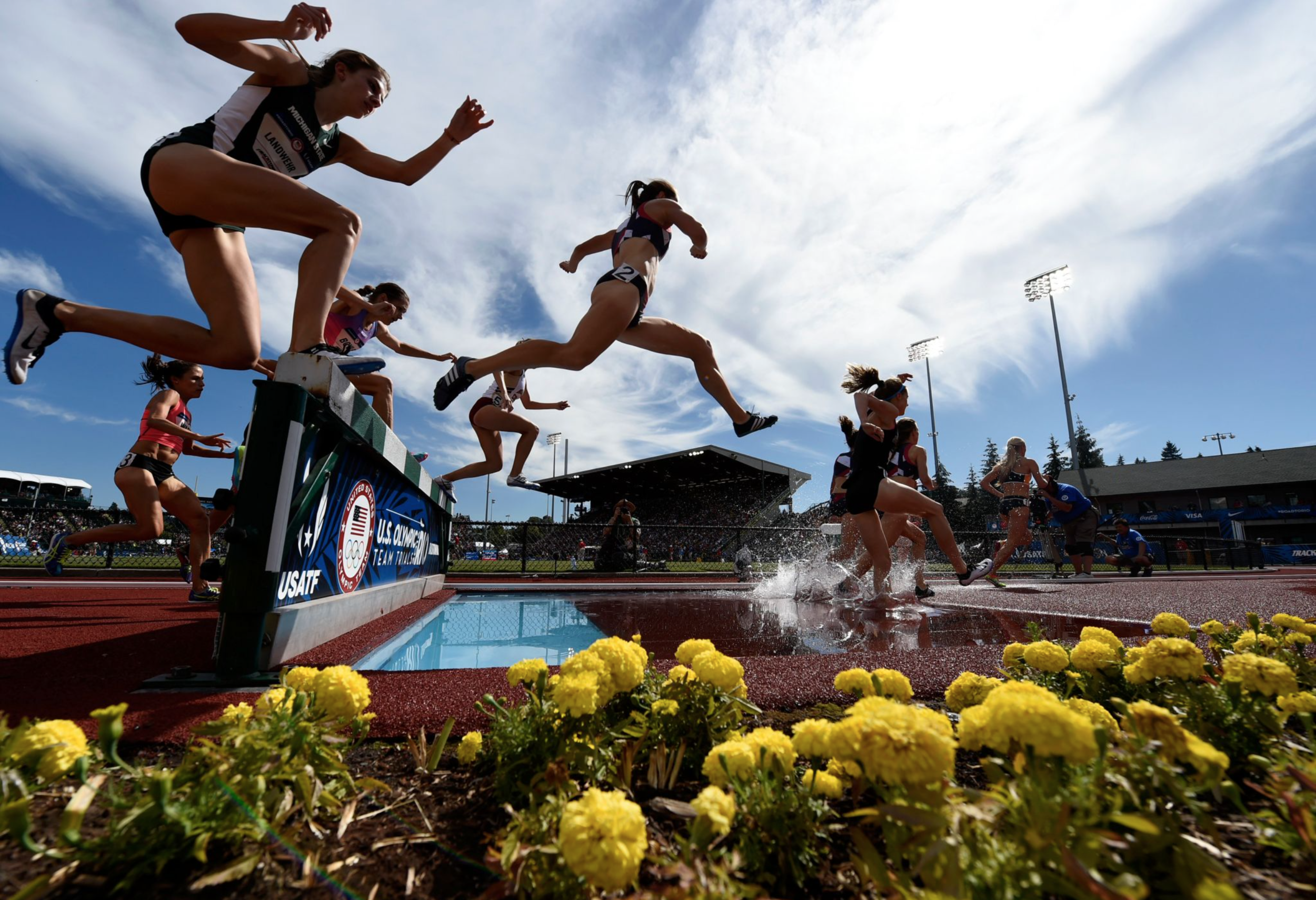 Competitors run in the women's 3,000-meter steeplechase event at trials.
