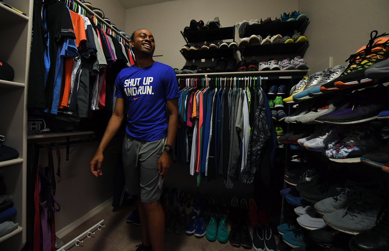 It's not surprising that someone who is a gold-medal hurdler would have a lot of shoes and Merritt keeps his gear nicely organized.