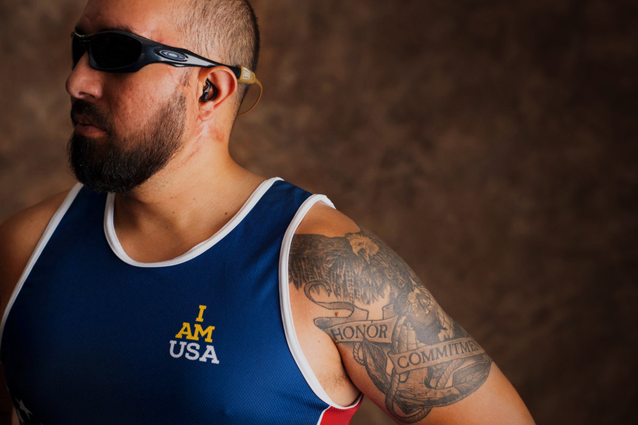 "Adrian ""AJ"" Mohammed, 35, is from Oconomowoc, Wisconsin. He served in the Navy and competed in tandem cycling and the 100 and 200 meters in track. He designed his tattoo himself."
