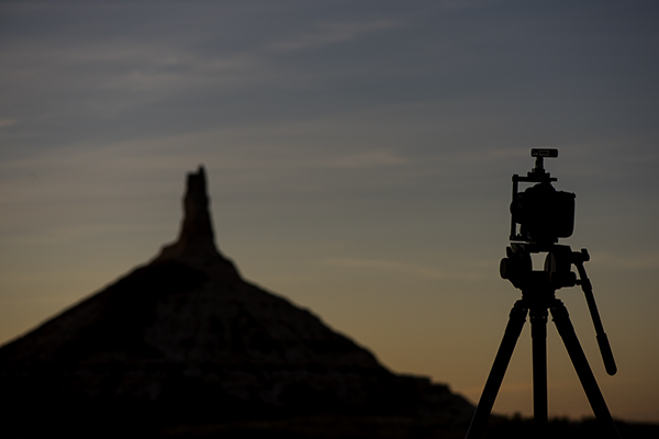 A D5 held up by a Manfrotto tripod looks into the sunset