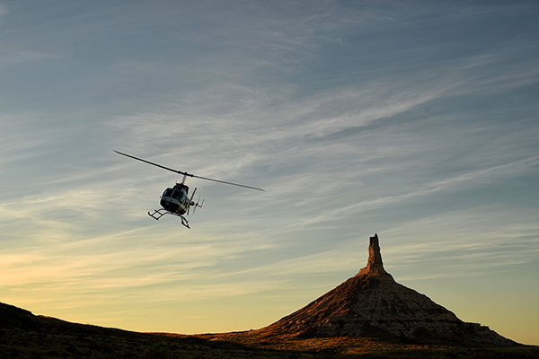 Shane's helicopter with Roy and I inside by Chimney Rock.