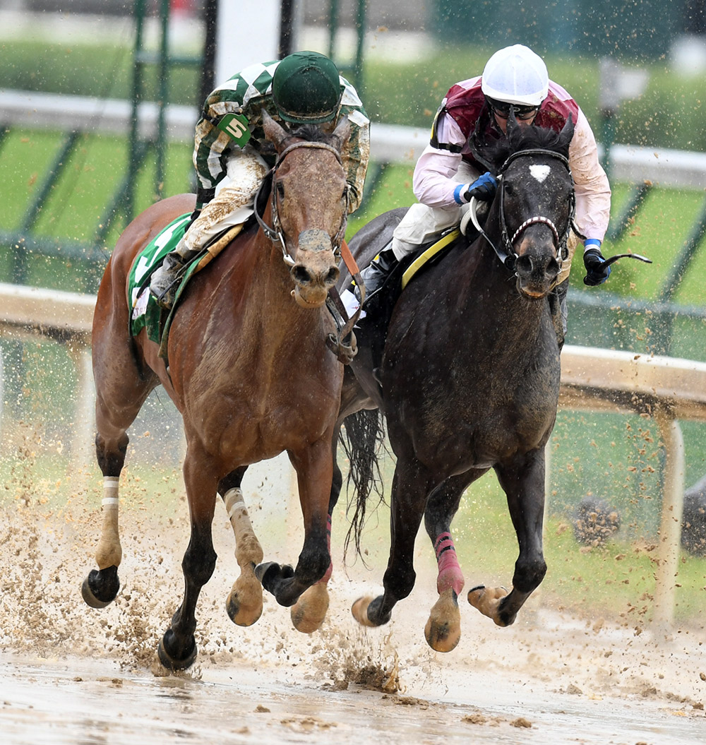 Hernandez, at left in green and white, races to the finish with Romantic Vision for the fifth race of the day at Churchill Downs on Friday. Romantic Vision placed (finished second) under Hernandez's guidance, just as Prudence had the day before.