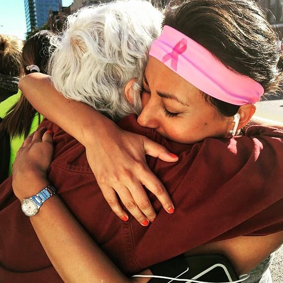 "Marilyn receiving a hug from her daughter Ella after she crossed the finish line of the Chicago Marathon, October 2015. ""I am extremely fortunate to have such a powerful role model."" - Elle Yeomans / Family Photo"