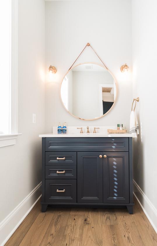 bathroom vanity ideas-circle mirror-photo by BKLP-1.jpg