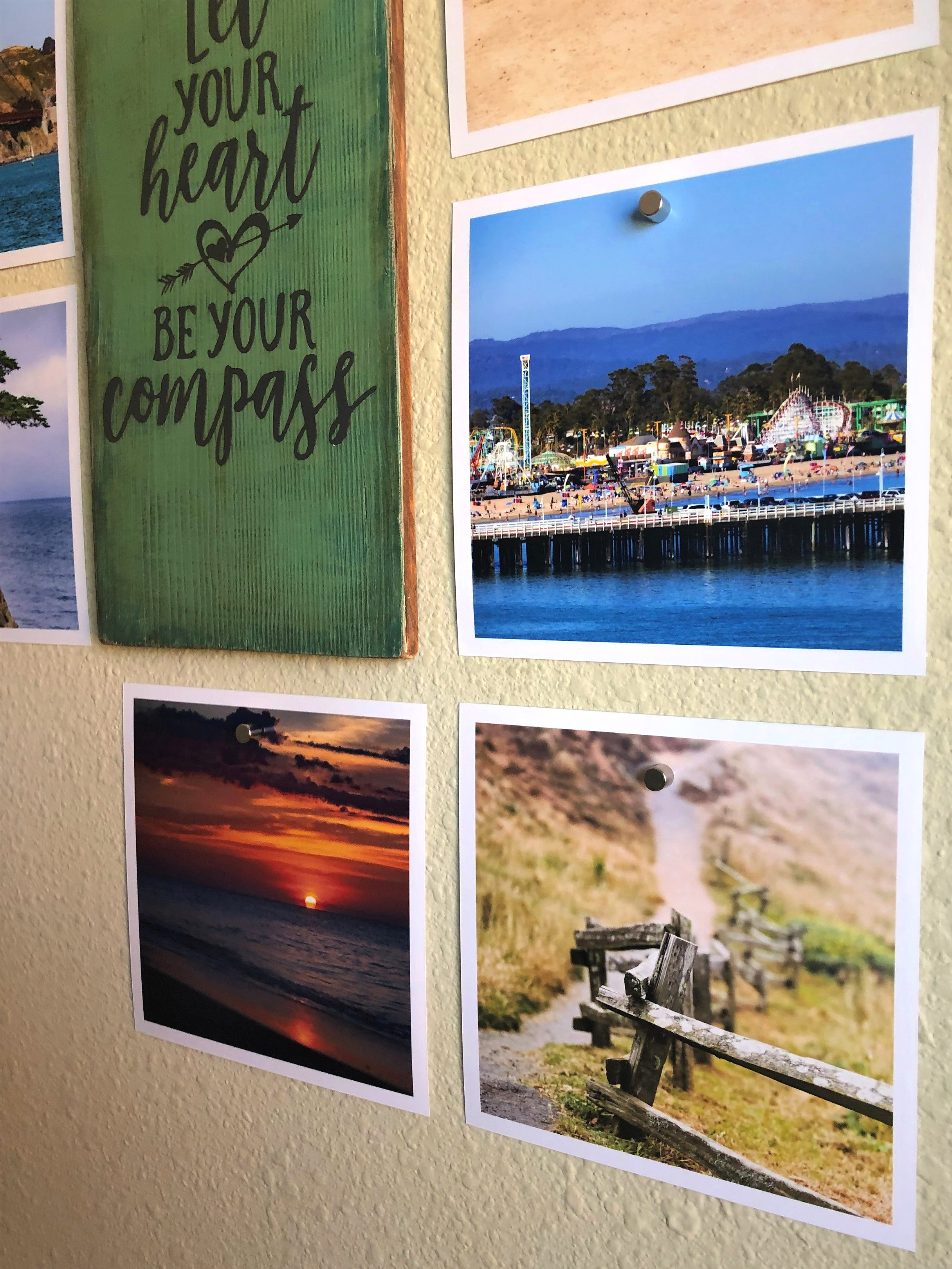 What's on the wall? - Sign made with Annie Sloan paint and Cricut. Photos are my travel photos.Goodhangups is an awesome product for holding up photos