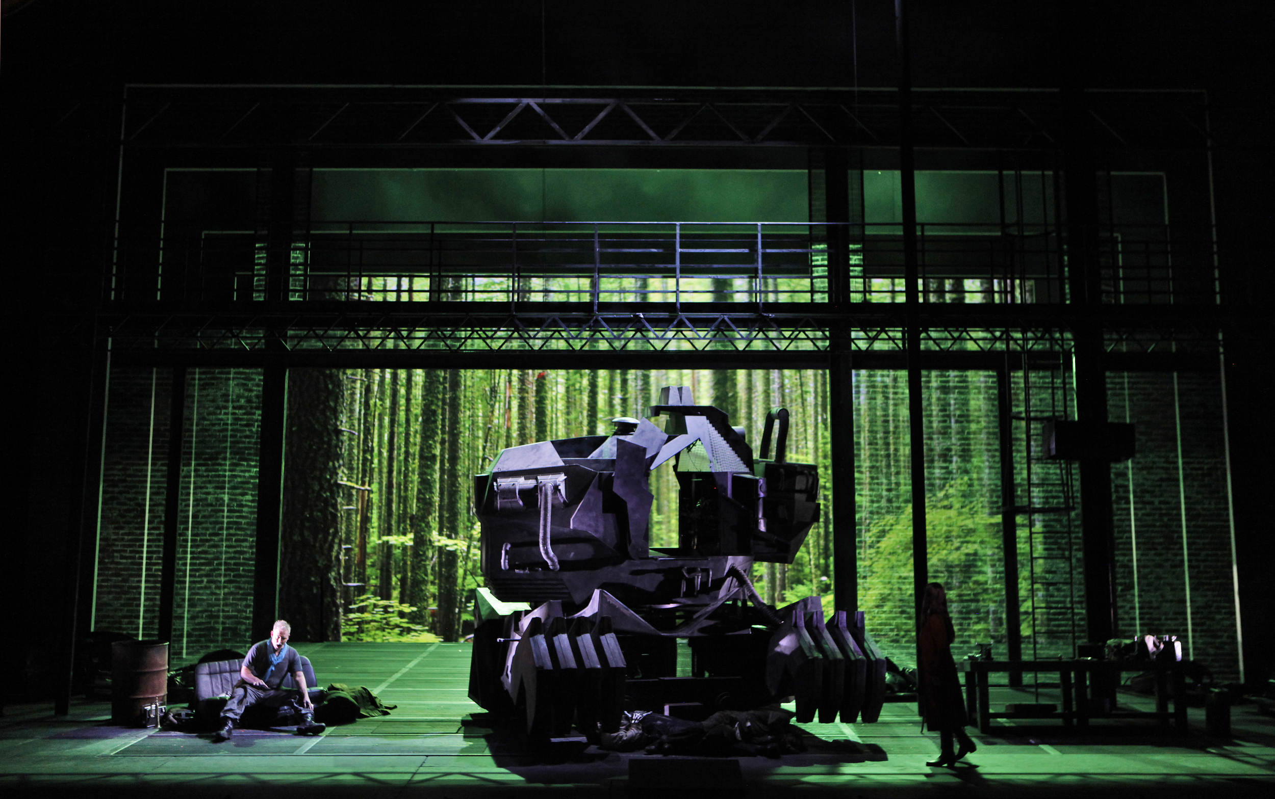Siegfried rests pondering next steps after dispatching the dragon (the form taken by the giant, Fafner, who along with Mime, lies expired in front of the dragon). Photo courtesy of the Washington National Opera/Kennedy Center.