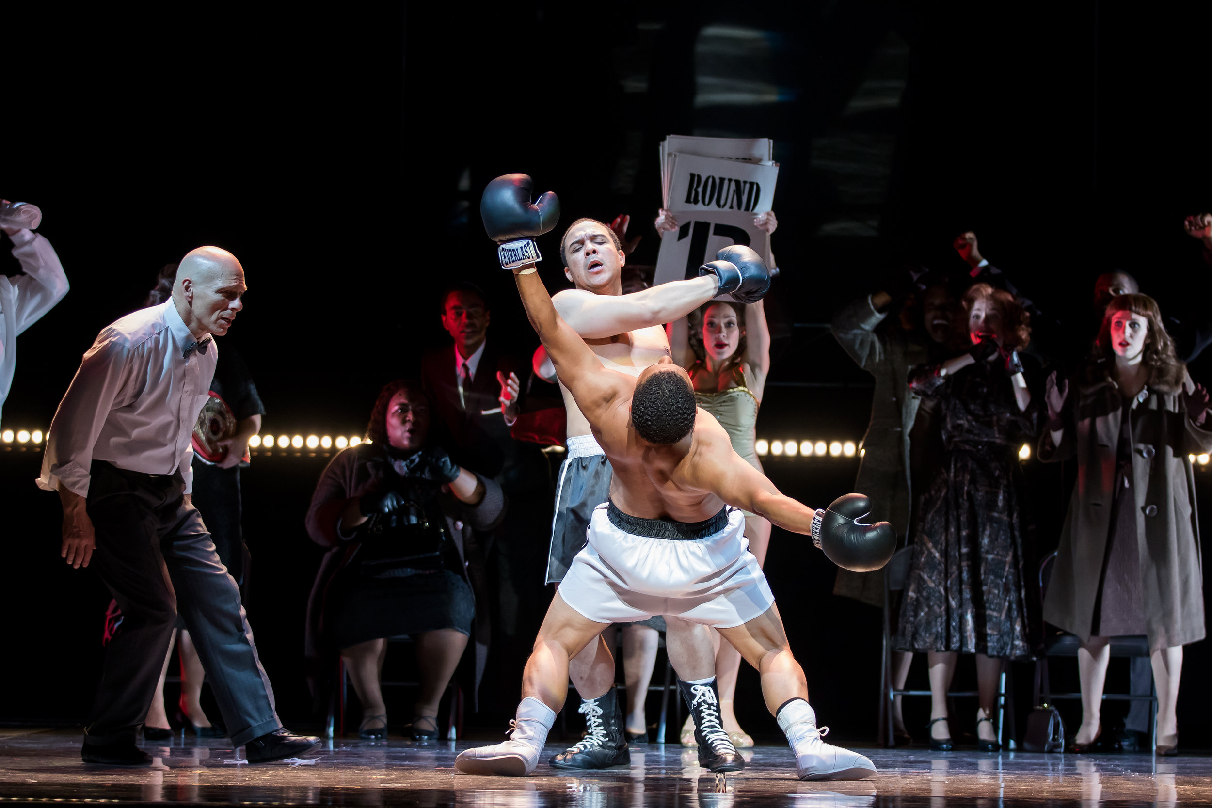 Griffith, Aubrey Allicock, knocking Paret, Victor Ryan Robertson, out. Photo by Scott Suchman and courtesy of Washington National Opera.