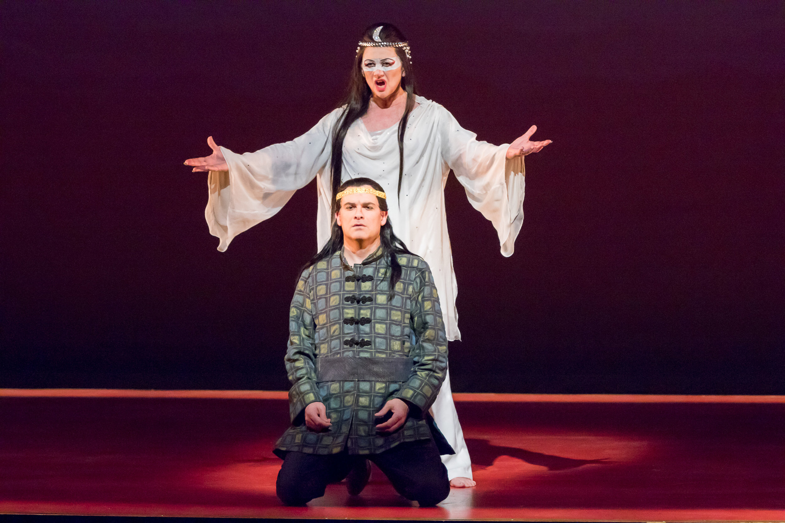 Turandot, Kelly Cae Hogan, stands above Prince Calaf, Derek Taylor. Photo by Ben Schill Photography; courtesy of Virginia Opera.