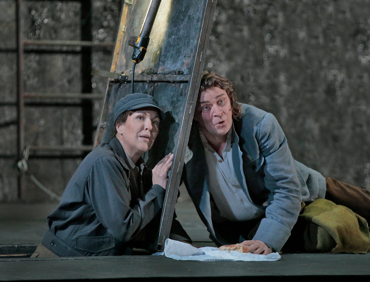 Adrianne Pieczonka as Leonore and Klaus Florian Vogt as Florestan  . Photo by Ken Howard; courtesy of the Metropolitan Opera.