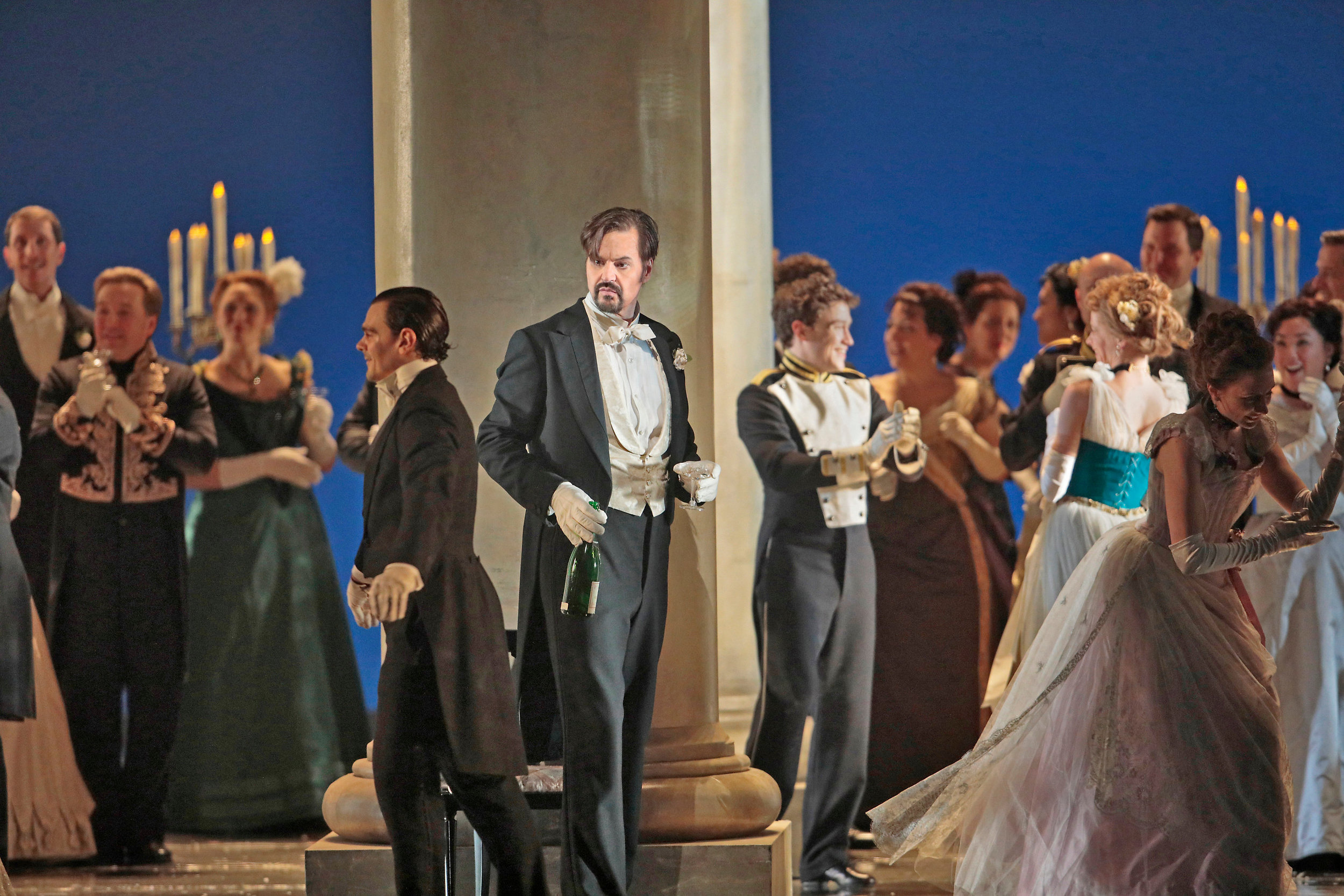 Peter Mattei as Onegin at an aristocratic party  . Photo by Ken Howard; courtesy of the Metropolitan Opera.