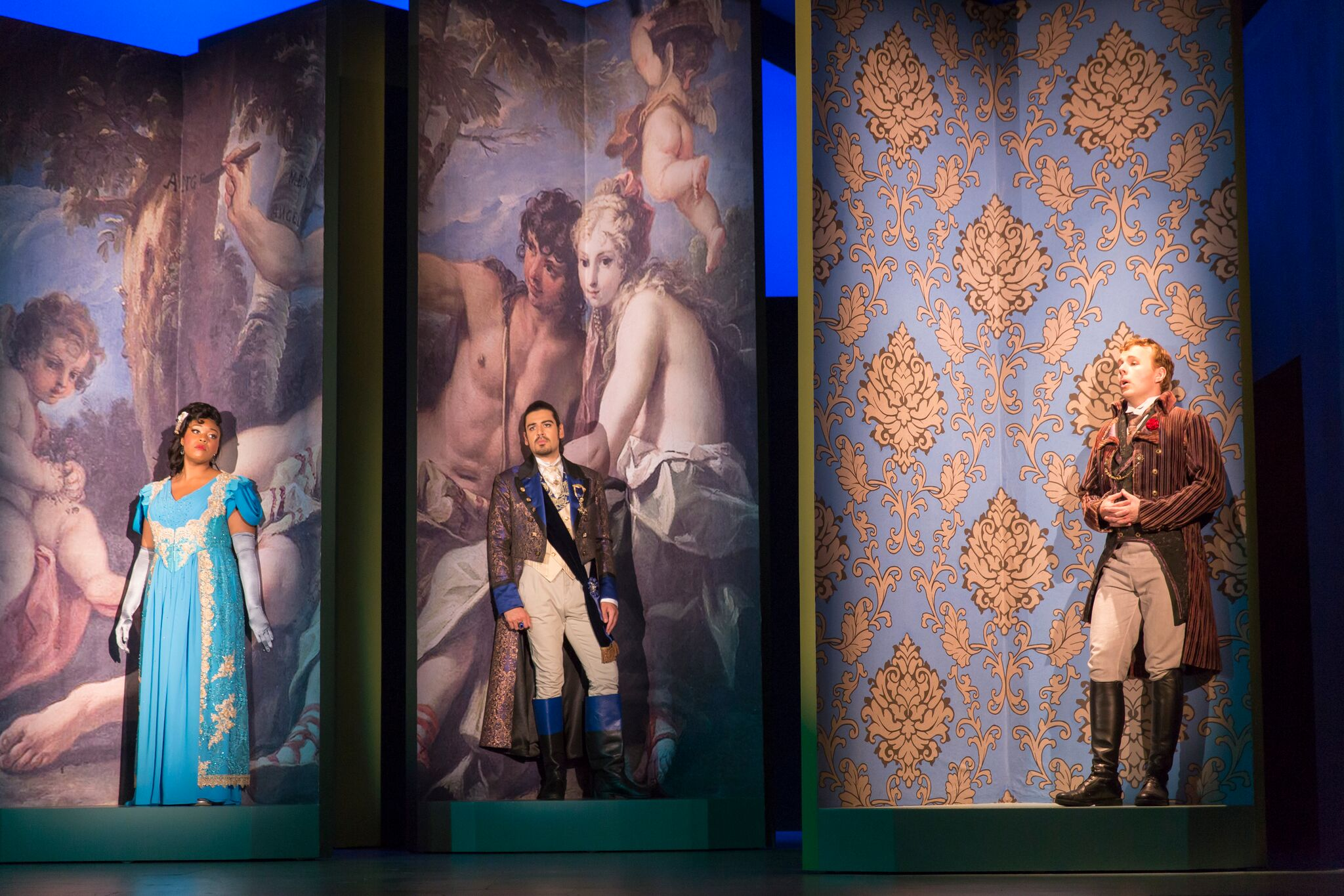 Rotating columns holding the members of  The Touchstone 's love triangle: Zoie Reams as Clarice; Richard Ollarsaba as Count Asdrubale; and Alasdair Kent as Giocondo. Photo by Scott Suchman and courtesy of Wolf Trap Opera.