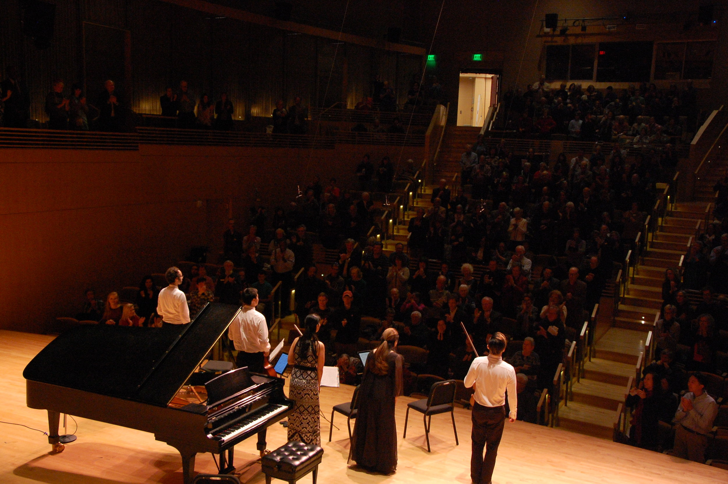 Photo of performers taken from back of stage; author and son in fourth row center. Photo by Ronald Fedorczak; courtesy of the Candlelight Concert Society.