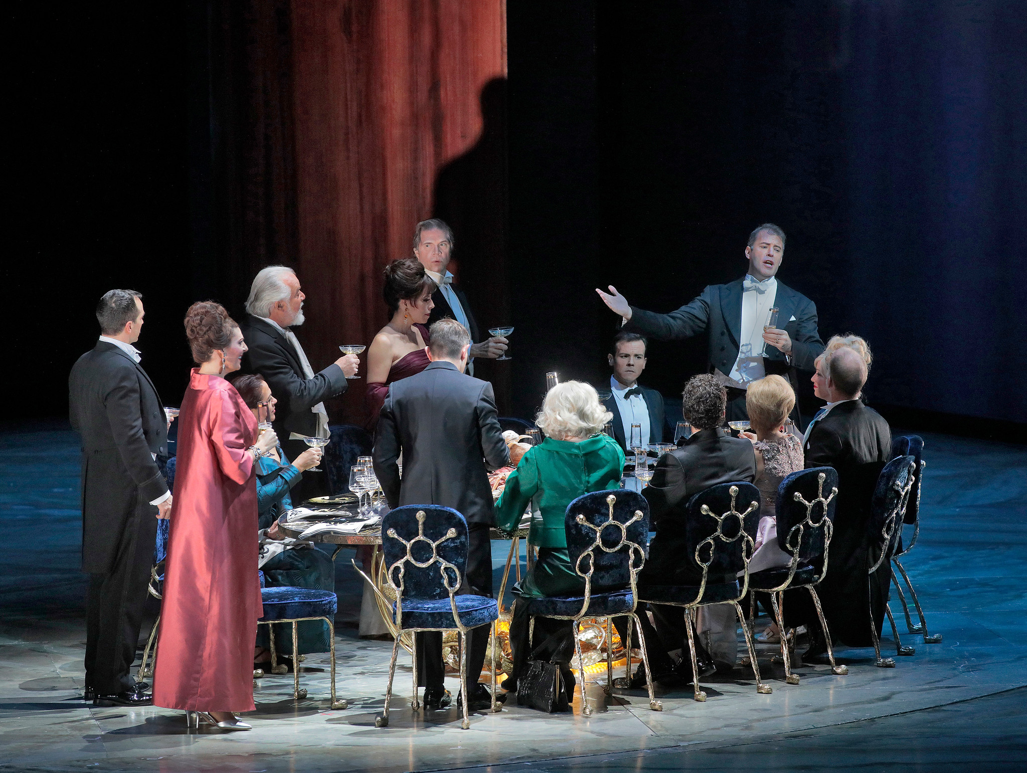 Society manners and personas rule the beginning of the dinner party in The Exterminating Angel. Photo by Ken Howard; courtesy of the Metropolitan Opera.