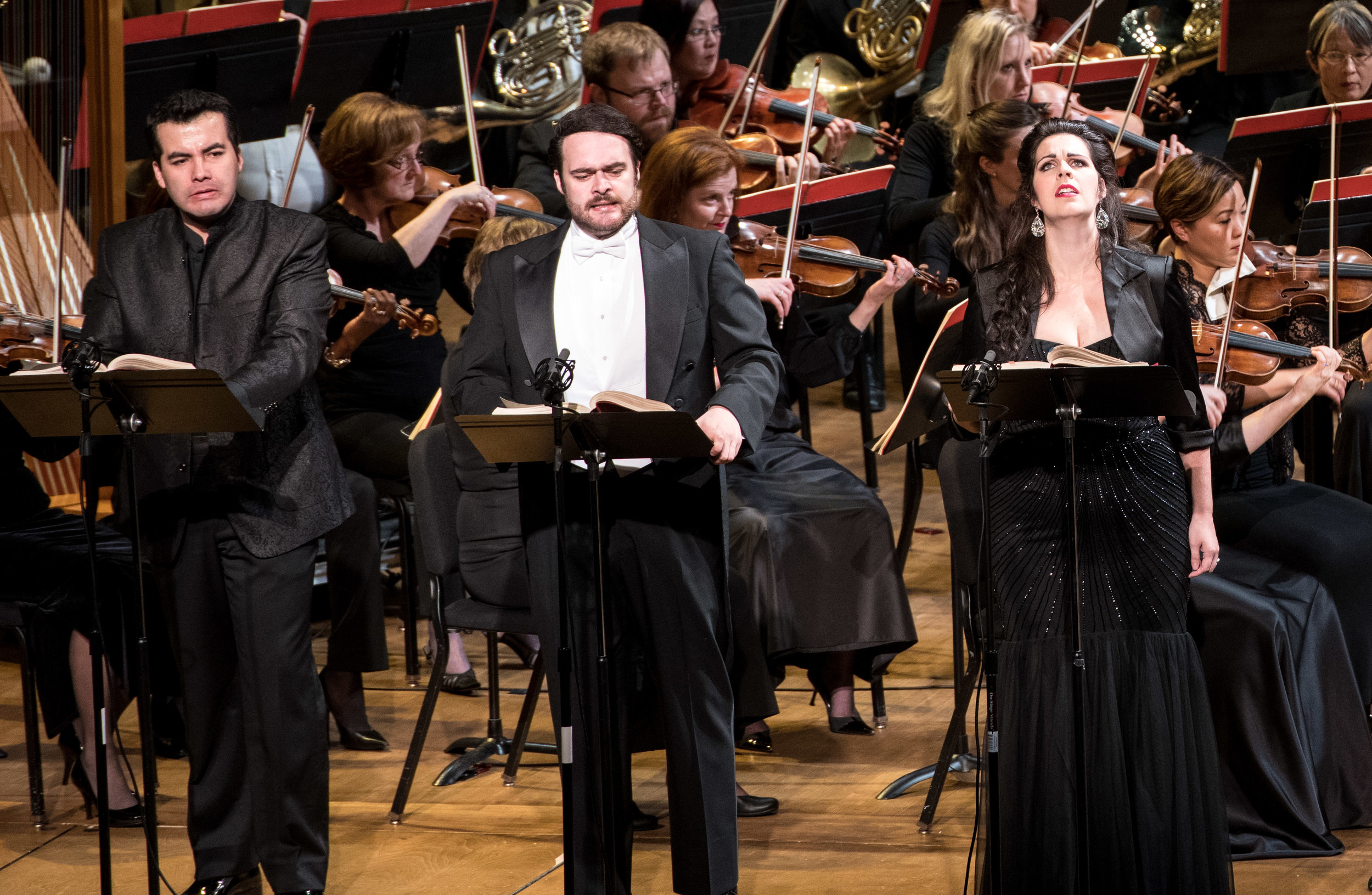 Javier Arrey as Valdeburgo, Gerald Schneider as Arturo, and Amanda Woodbury as Alaide. Photo by Don Lassell; courtesy of Washington Concert Opera.