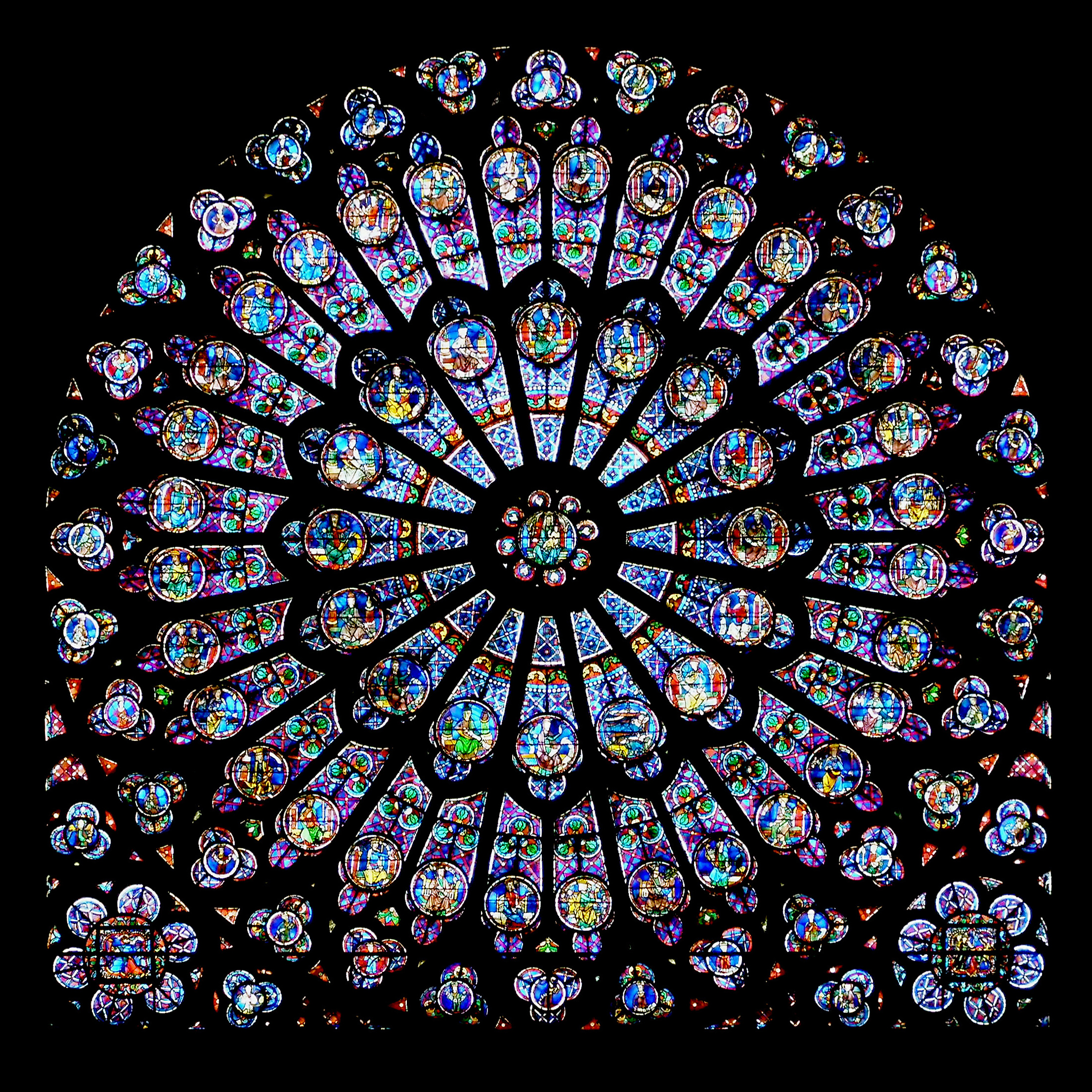 """Rayonnant rose window in Notre Dame de Paris. In Gothic architecture, light was considered the most beautiful revelation of God"", says  Wikipedia's caption . I might contend that the human voice can be even more effective at revealing beauty than a stained glass window. Photo from  Wikipedia commons ."