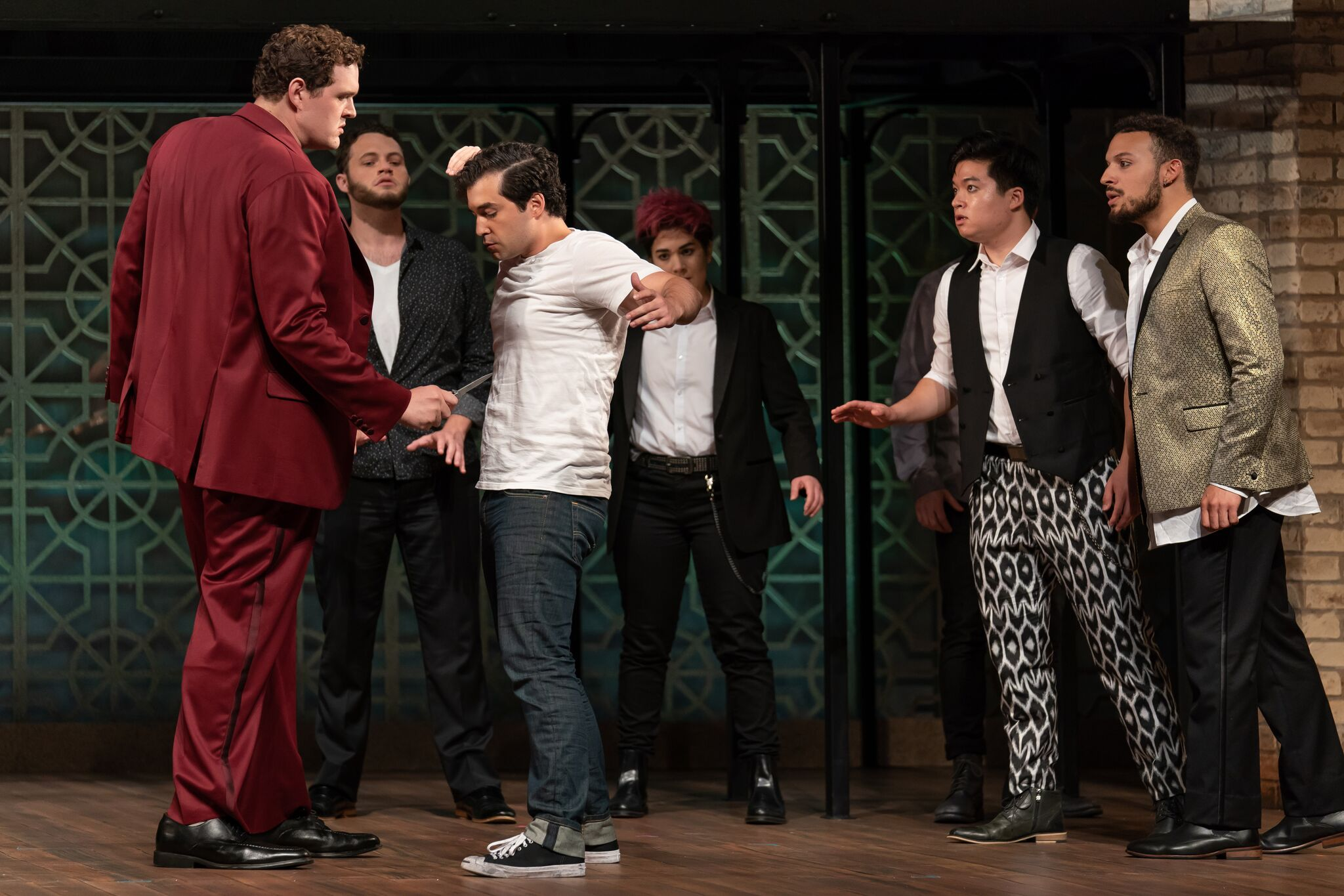 Tybalt (Richard Trey Smagur) confronts Romeo (Alexander McKissick) with a knife while onlookers are, l to r, Mercutio (Thomas Glass), Stephano (Amy Rosen), Duke Kim, and Cory McGee. Photo by Scott Suchman; courtesy of Wolf Trap Opera.