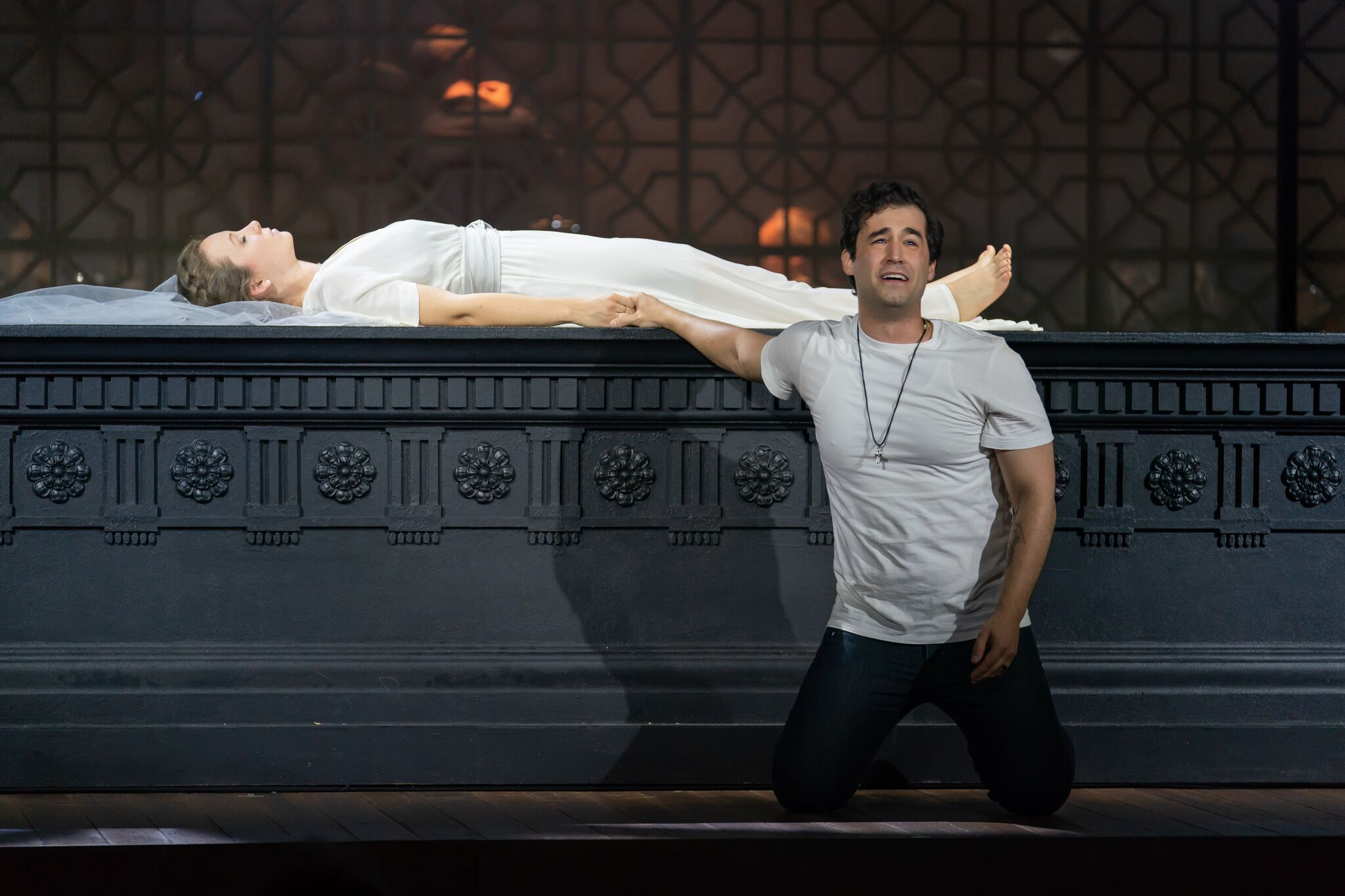 Romeo (Alexander McKissick) believes a sleeping Juliet (Madison Leonard) to be dead. Photo by Scott Suchman; courtesy of Wolf Trap Opera.
