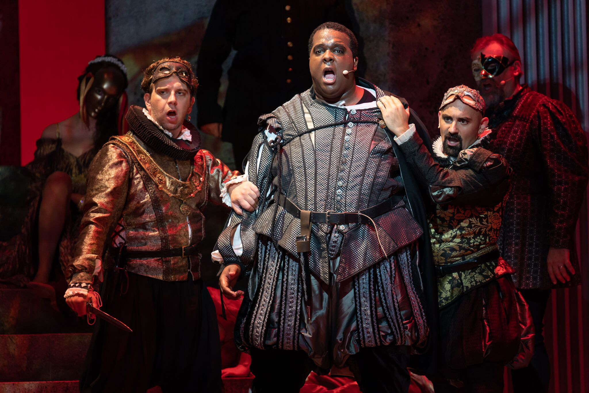 Johnathan McCullough as Marullo, Joshua Conyers as Count Monterone, and Nicholas Nestorak as Matteo Borsa, as the two courtiers restrain the enraged Count. Photos by Scott Suchman; courtesy of Wolf Trap Opera.