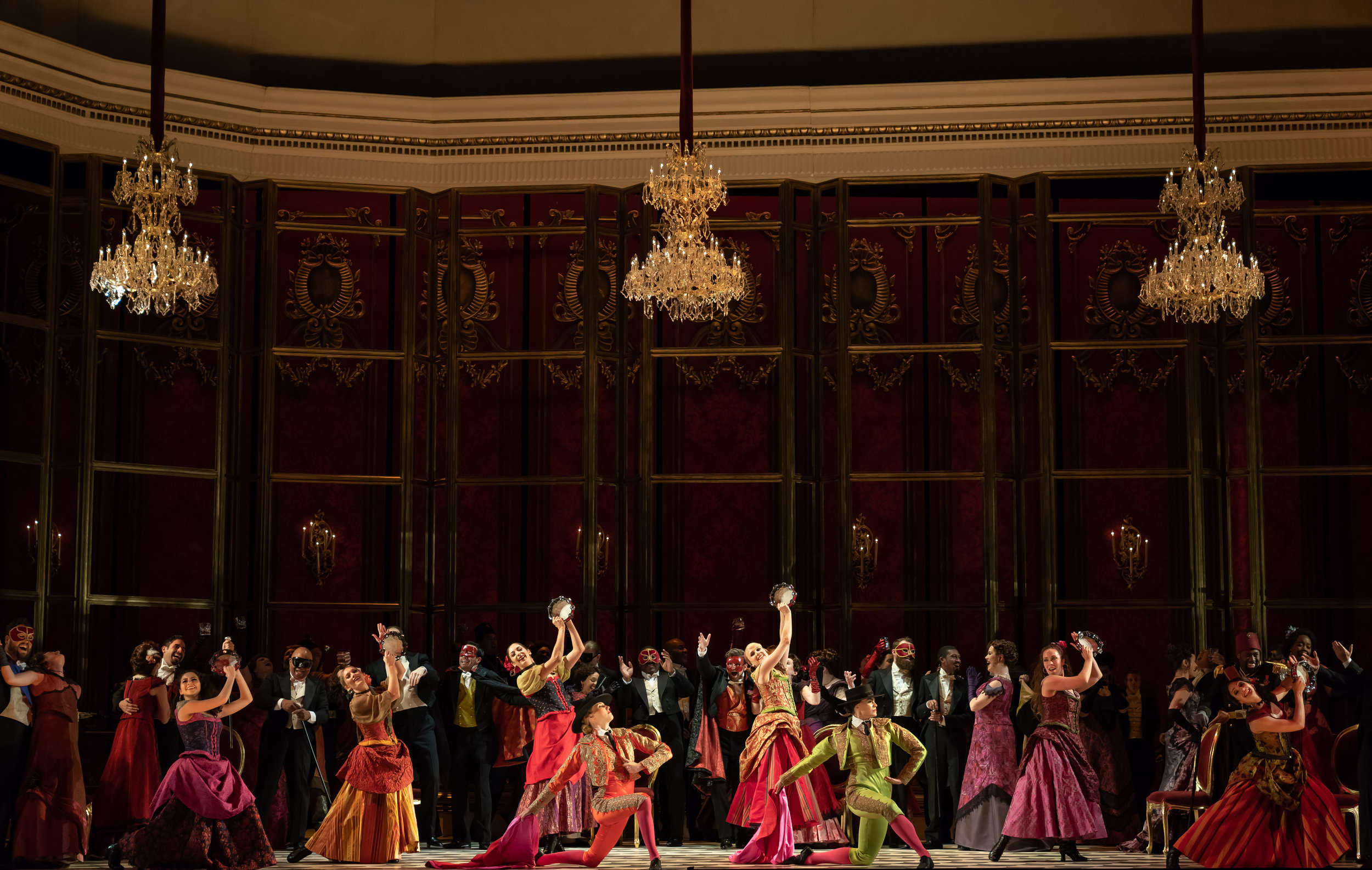 Dancers and matadors enliven the party during WNO's La traviata 2018 production_credit Scott Suchman.jpg