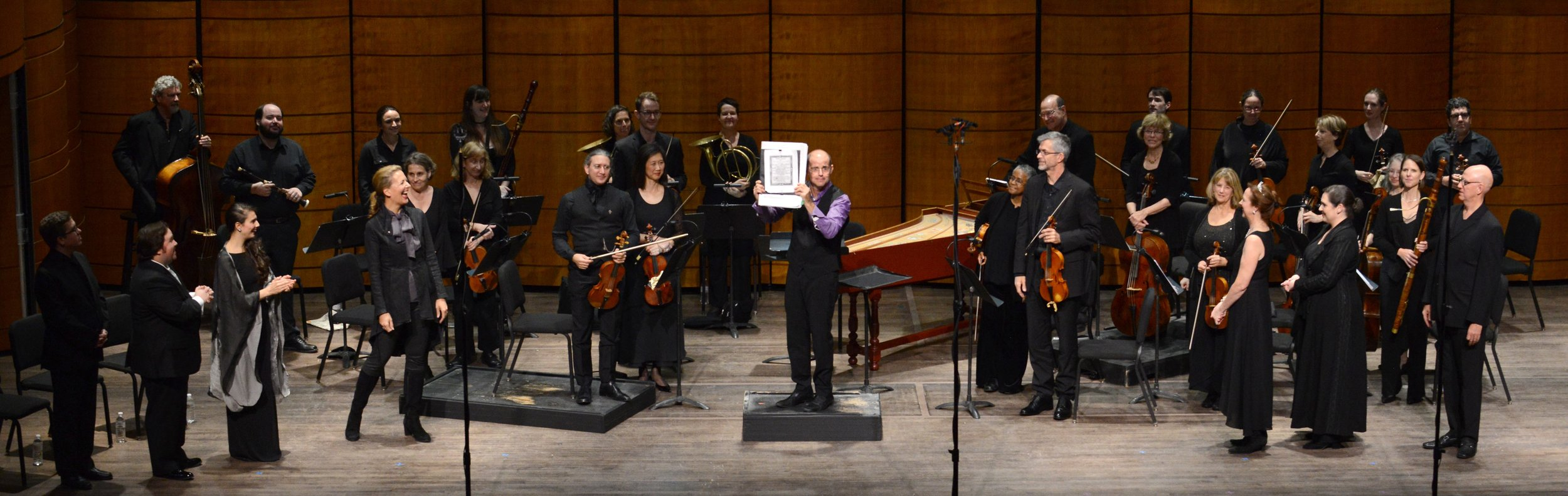 In a curtain call for  Cerere Placata 's first performance in 246 years, at center, Conductor Charles Brink holds up his copy of Jommelli's score. Photo by Russell Hirshorn; courtesy of Opera Lafayette.