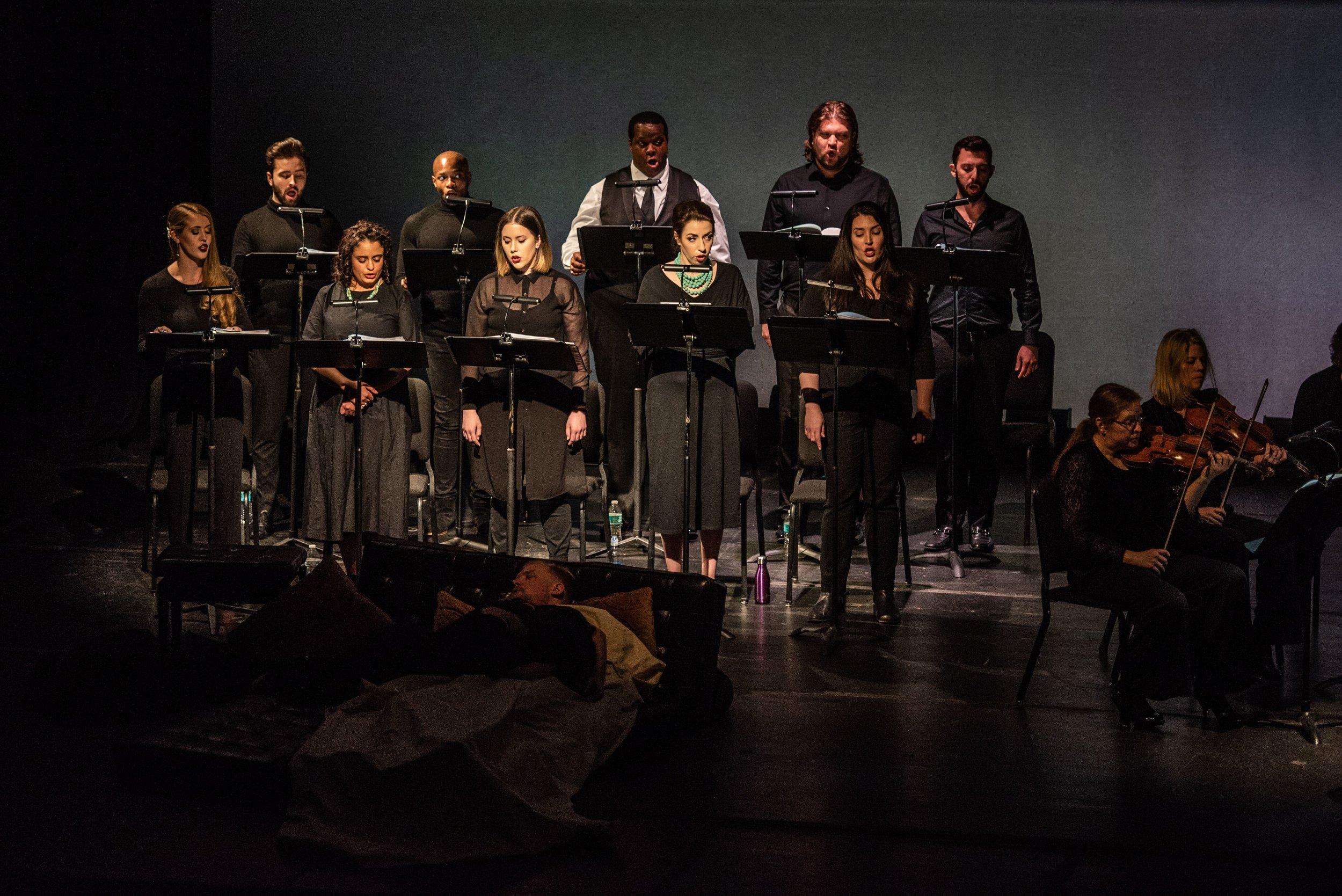 With the unhappy lovers in mortal repose, the chorus (front row, left to right: Meagan Sill, Summer Hassan, Nicole Thomas, Renée Rapier, and Leah Marie Heater; back row, left to right: Joshua Sanders, Frederkick Ballantine, Joshua Conyers, Anthony Robin Schneider, and Matthew Fleisher.) provides closing remarks. Photo by Angelina Namkung for Wolf Trap; courtesy of Washington Concert Opera and Wolf Trap Opera.