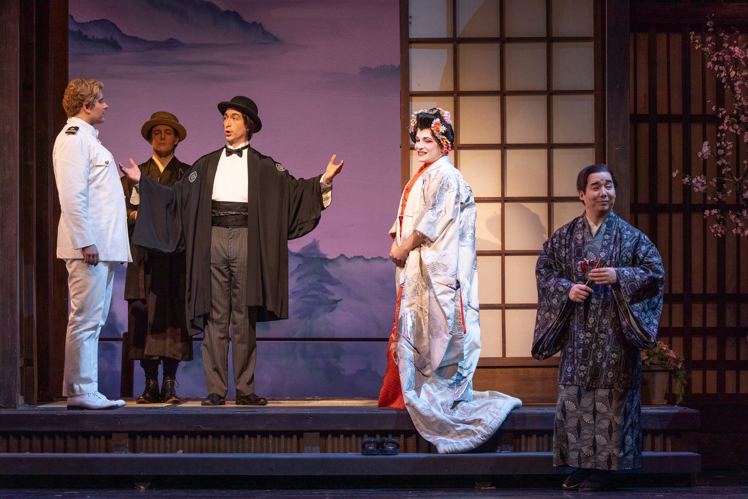 Matthew Vickers as Pinkerton, Joseph Hubbard as the Imperial Commissioner performing the ceremony, Danielle Pastin as Cio-Cio-San, and Julius Ahn as Goro, the marraige broker. Photo by Ben Schill Photography; courtesy of Virginia Opera.