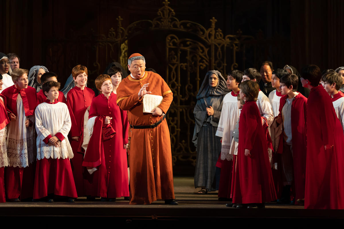 Wei Wu as Sancristan and the Children's Chorus. Photo by Scott Suchman; courtesy of Washington National Opera.
