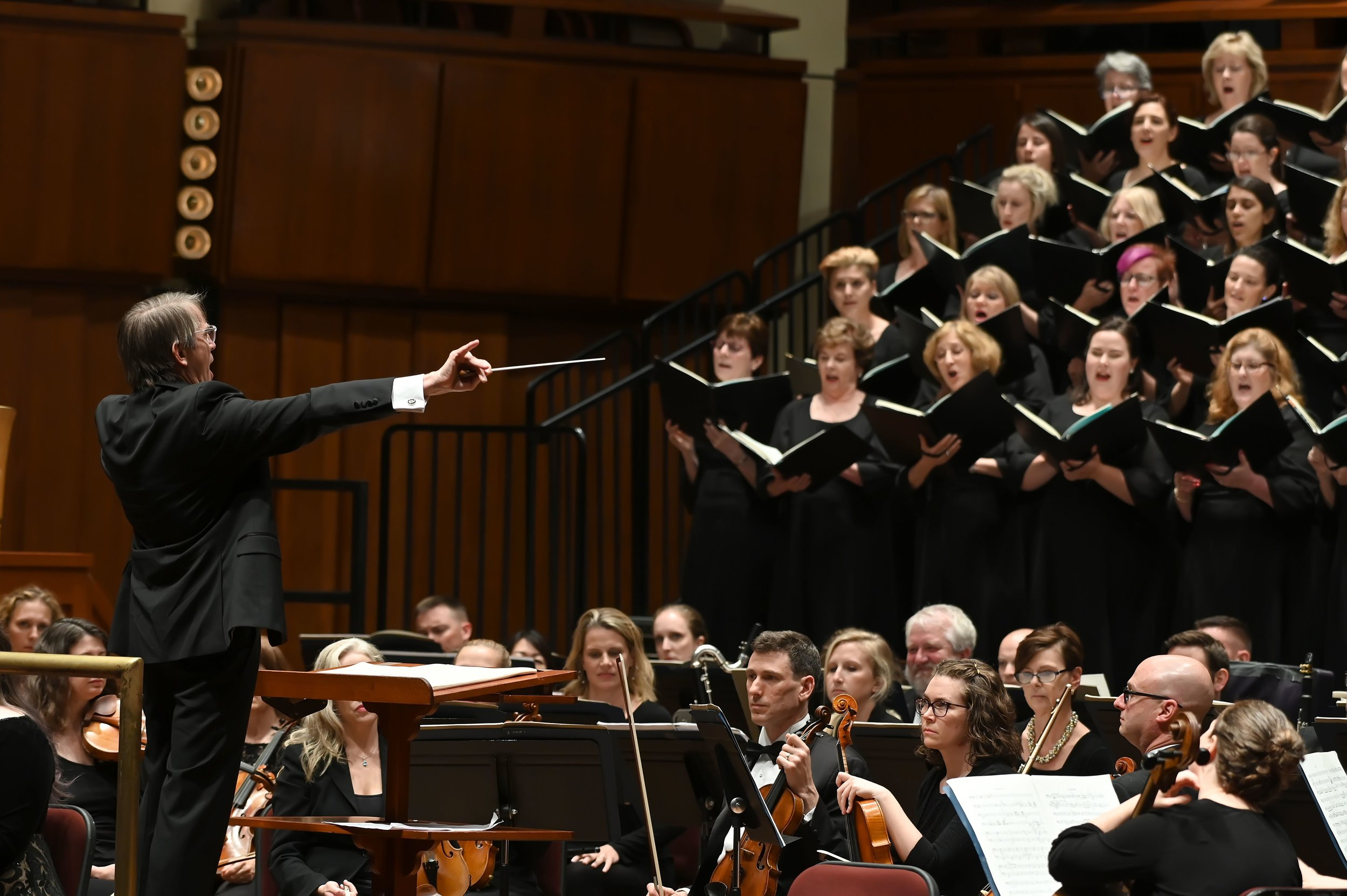 Conductor Scott Tucker facing the orchestra and chorus. Photo by Shannon Finney Photography; courtesy of The Choral Arts Society of Washington.