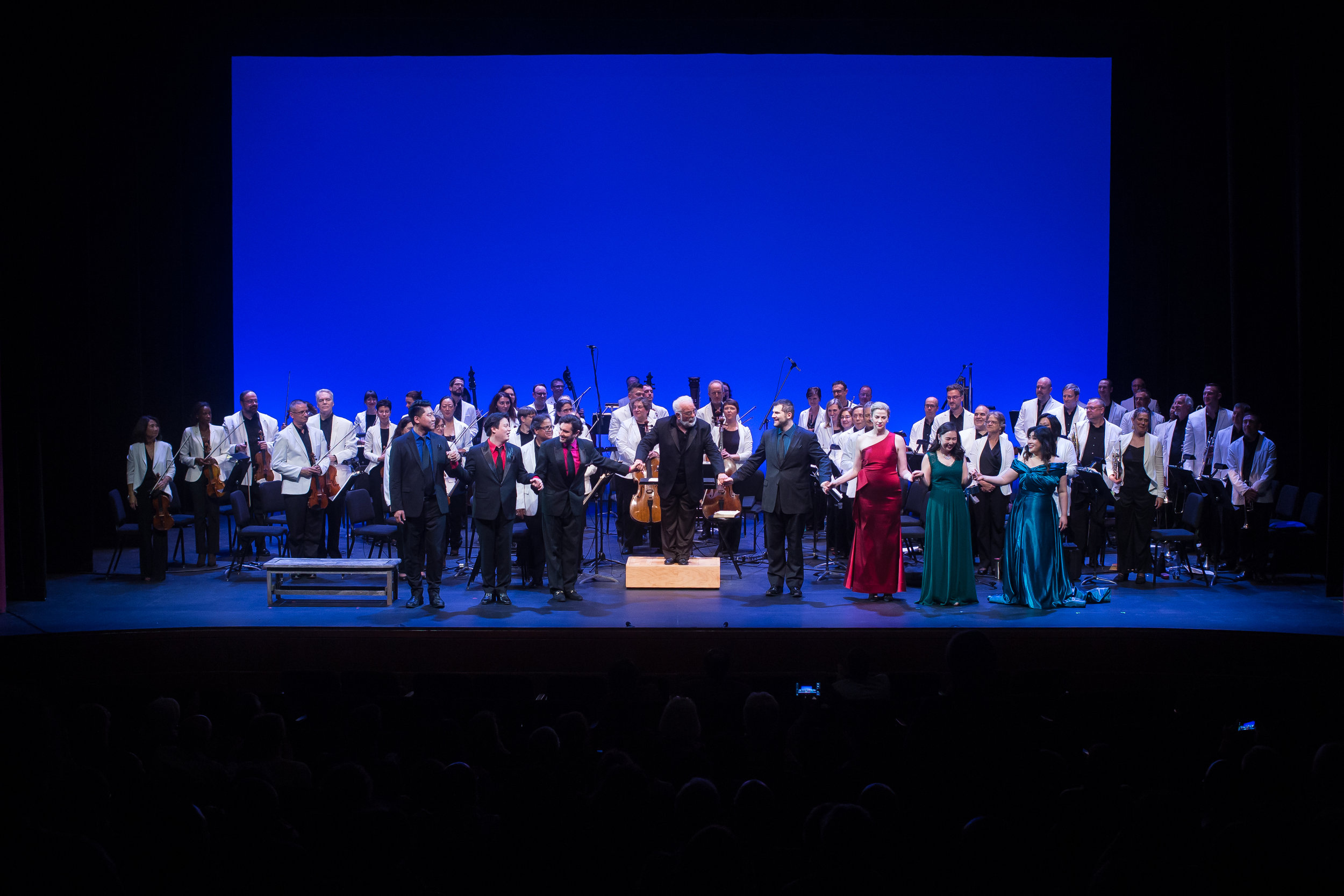 Curtain call:  l to r , SeungHyeon Baek, Yongxi Chen, Mauricio Miranda, Conductor Louis Salemno, Marco Cammarota, Catherine Martin, Nayoung Ban, and Youna Hartgraves. Photo by Dhanesh Mahtani; courtesy of Maryland Lyric Opera..