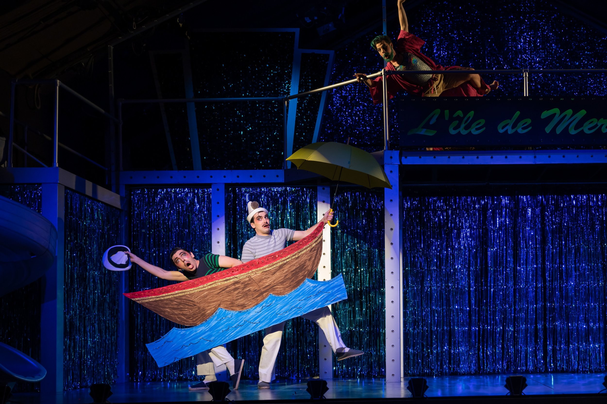 l to r : Two sailors from Paris, Scapin (Daniel Noyola) and Pierrot (Ben Edquist) approach Atlantis as Merlin (Conor McDonald) tracks them overhead. Photo by Scott Suchman; courtesy of Wolf Trap Opera.