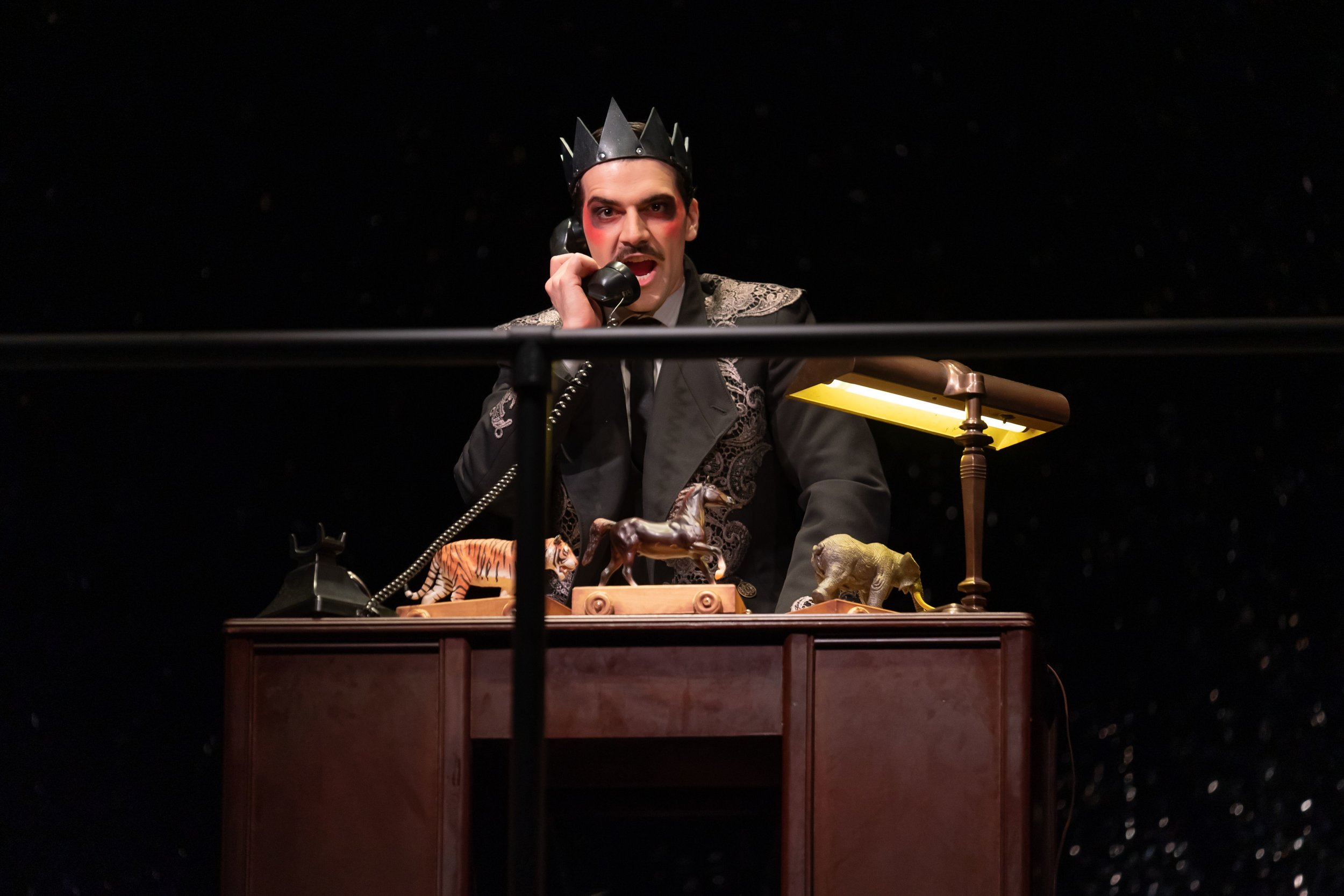 Emperor Overall (Ben Edquist) isolated and ruling from his office. Photo by Scott Suchman; courtesy of Wolf Trap Opera.