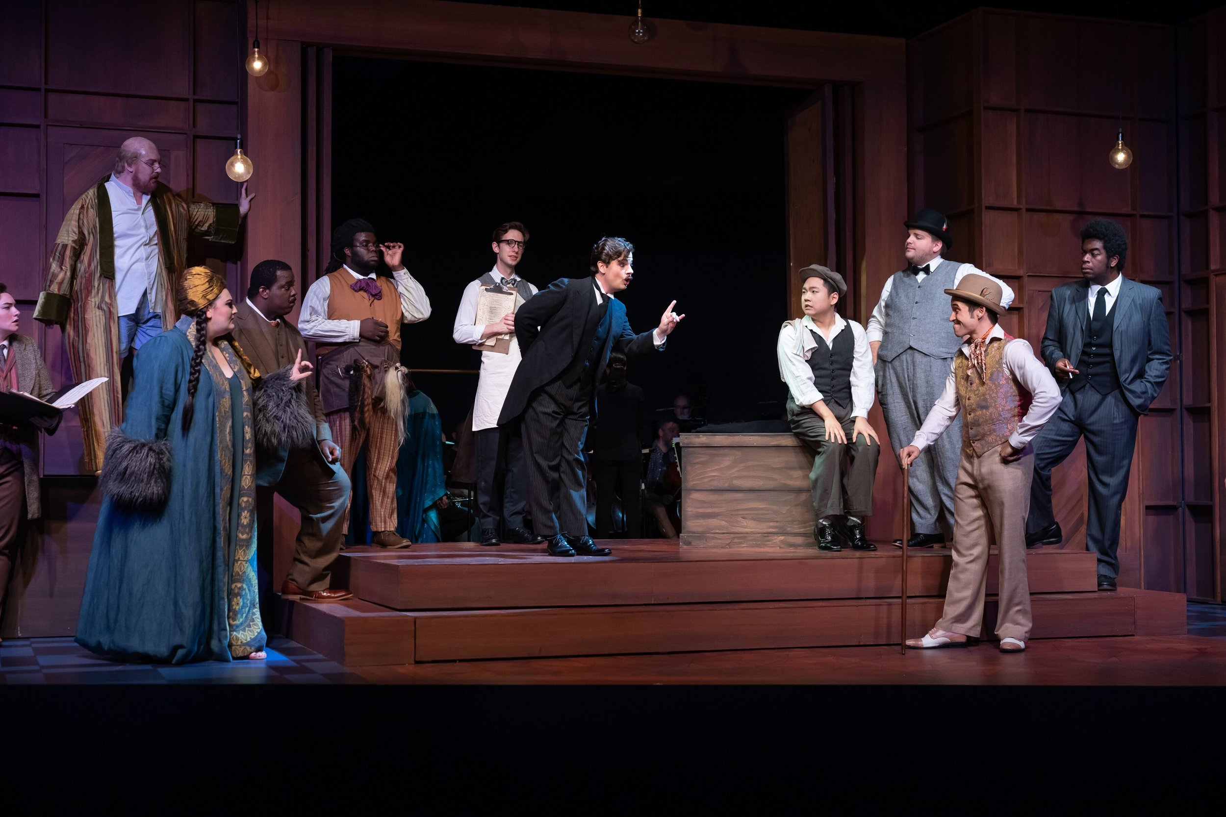 l to r : Lindsay Kate Brown (Composer), Ian Koziara (Tenor), Alexandria Shiner (Prima Donna), Joshua Conyers (Music Master), Wilford Kelly (Wigmaker), Jeremy Harr (Lackey), Conor McDonald (Major-Domo), Seiyoung Kim (Brighella), Victor Cardamone (Scaramuccio), Ian McEuen (Dancing Master) and Ron Dukes (Truffaldin) in the Prologue. Photo by Scott Suchman; courtesy of Wolf Trap Opera.