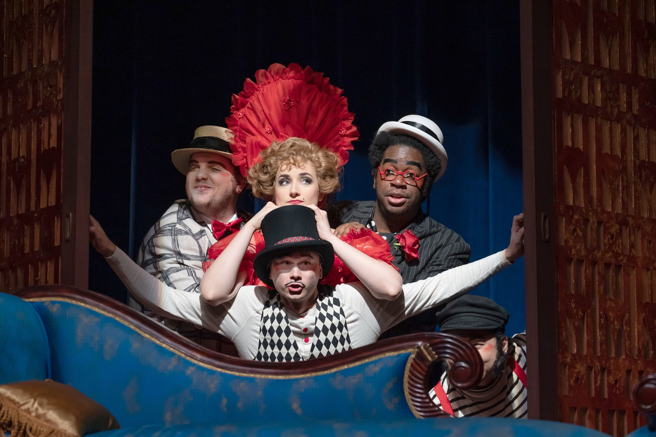 l to r .:Victor Cardamone as Scaramuccio, Alexandra Nowakowski as Zerbinetta, Ron Dukes as Truffaldin, and  (bottom)  Michael Pandolfo as Harlekin taking their turn in the Opera/comedy mashup. Photo by Scott Suchman; courtesy of Wolf Trap Opera.