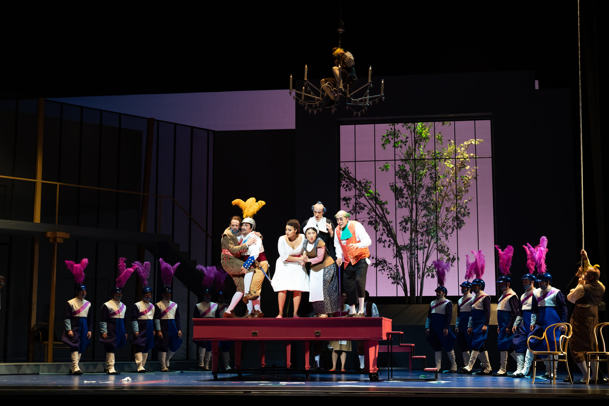 l to r on the grande piano: Johnathan McCullough as Figaro, Christopher Bozeka as Almavira, Taylor Raven as Rosina, Niru Liu as Berta, Patrick Guetti as Don Basilio, and Calvin Griffin as Dr. Bartolo. Photo by Scott Suchman; courtesy of Wolf Trap Foundation for the Performing Arts.