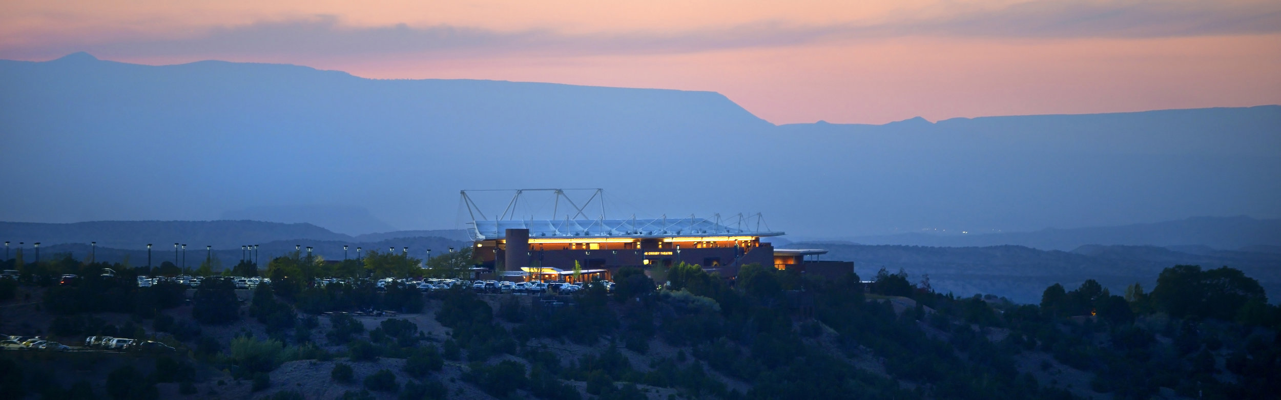 View of the Santa Fe Opera complex with the territory of the Tesuque Pueblo as backdrop. Photo by Robert Godwin; courtesy of Santa Fe Opera.