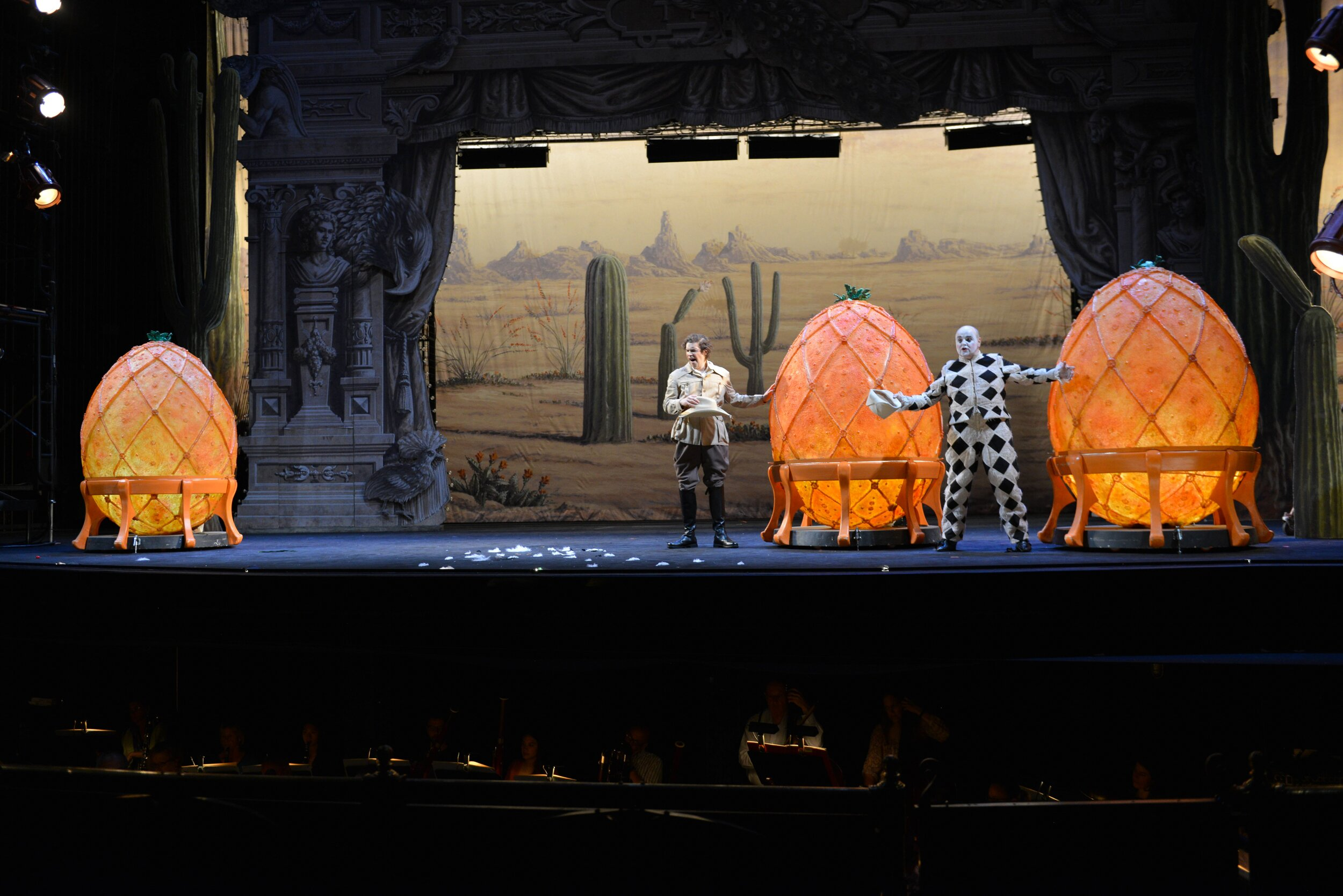 The three oranges, once secured by the Prince (Jonathan Johnson) and Truffaldino (Barry Banks), have grown. Photos by Kelly & Massa; courtesy of Opera Philadelphia.