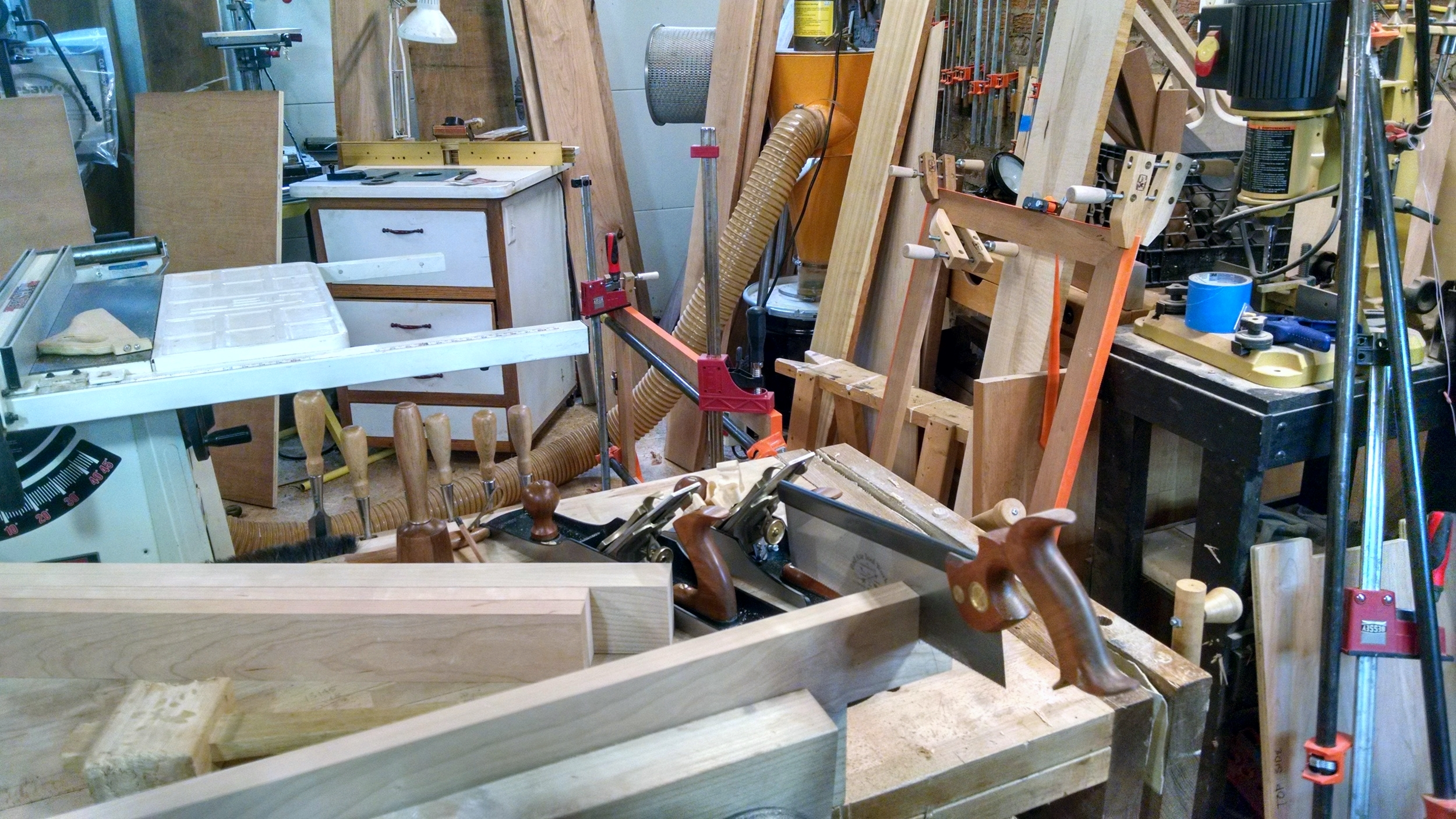 I've moved to hand tools here...cutting joinery for base pieces with my favorite BadAxe saw