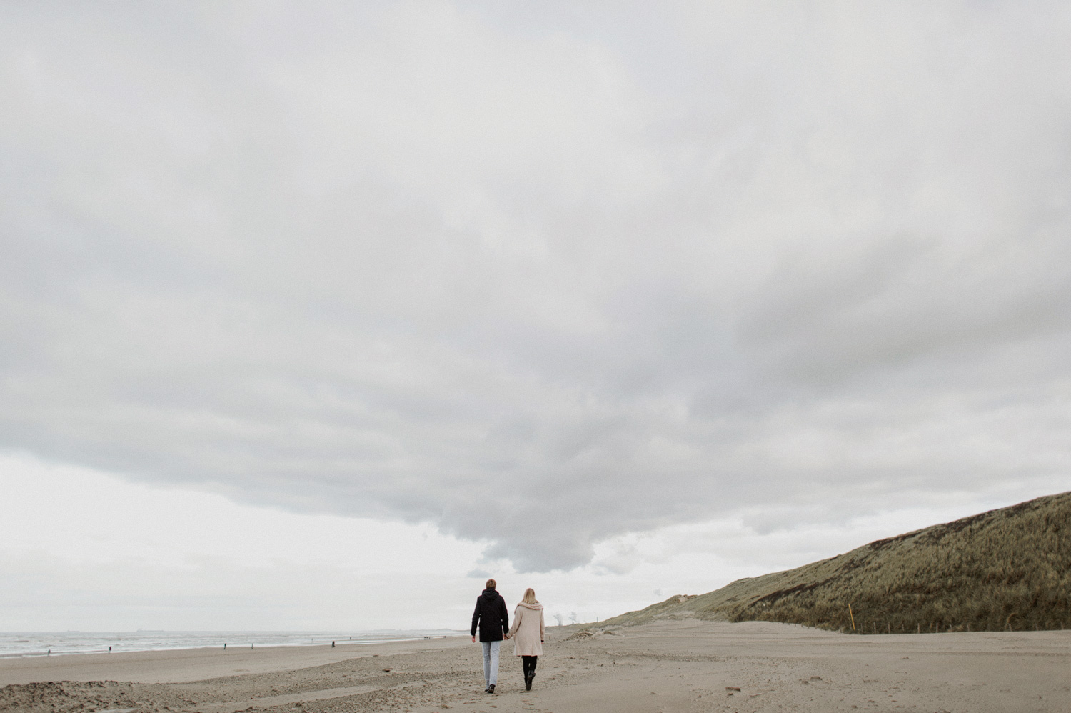 Couple walking on the beach of Bloemendaal