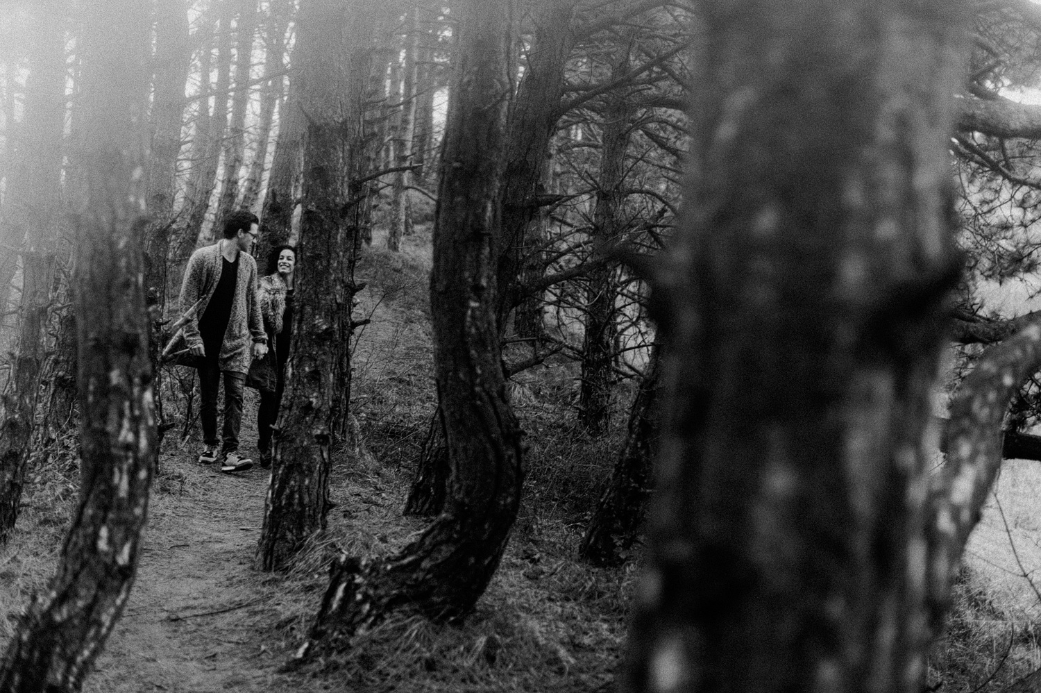 Couple walking towards the camera in forrest