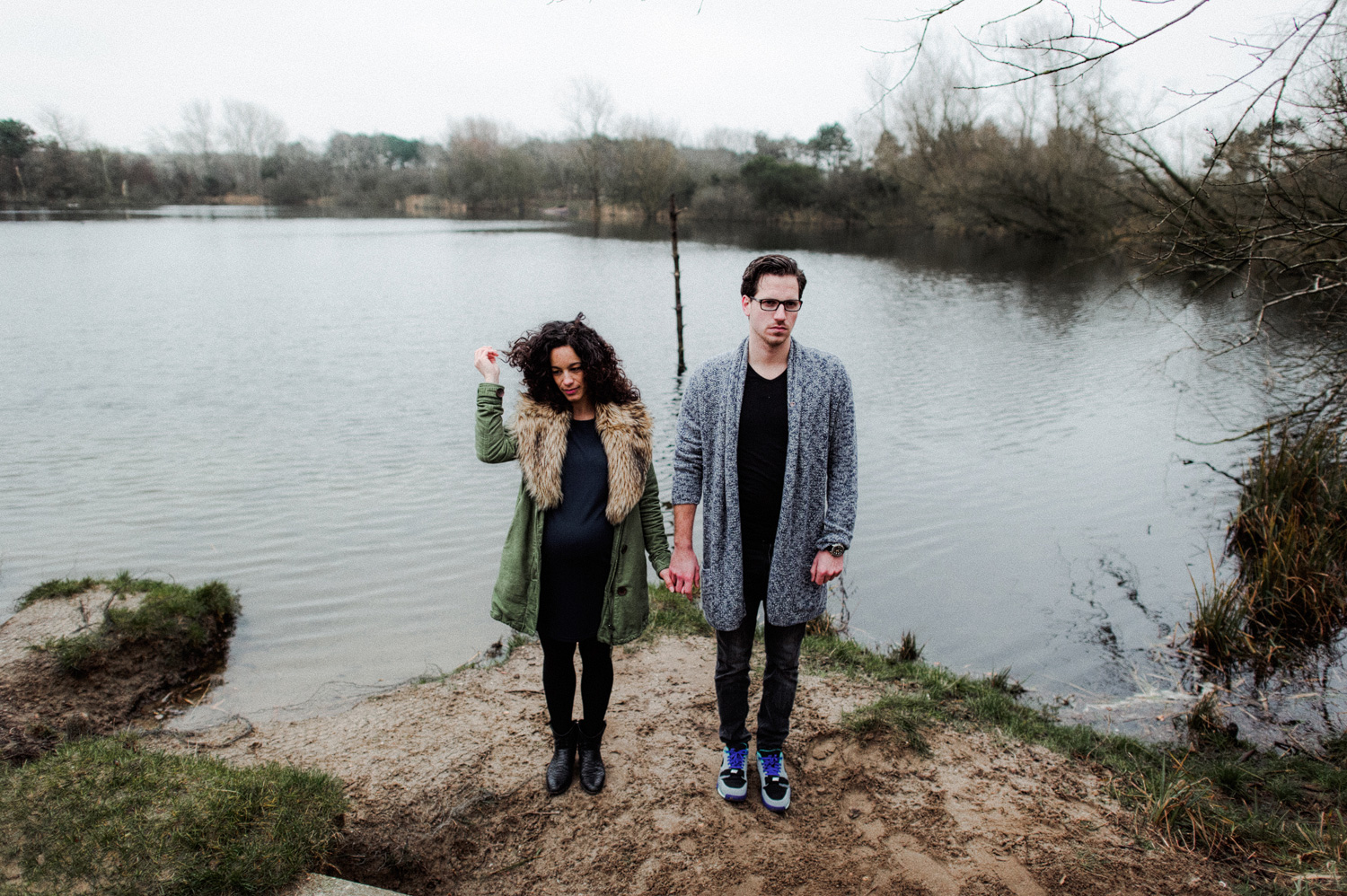 Couple standing in front of lake