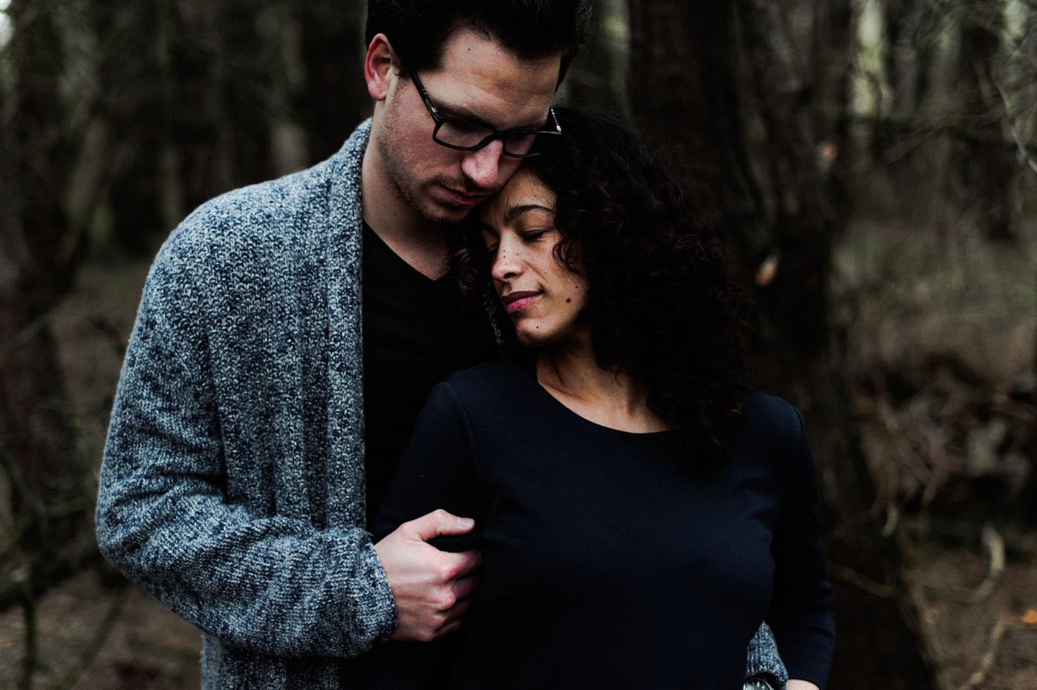 Close up of couple standing in forrest