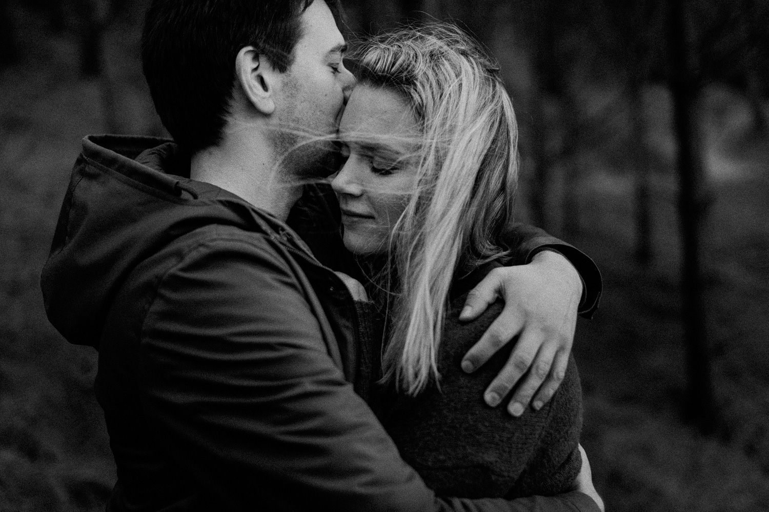 Close up of couple hugging in the forrest