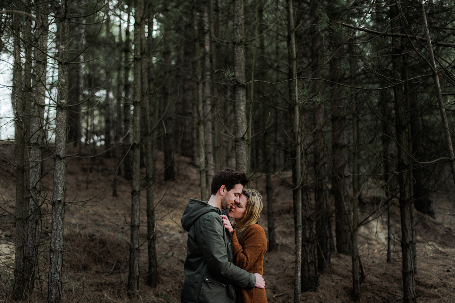 Couple almost kissing in the woods