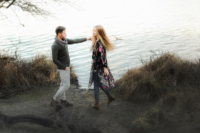 Couple dancing on shoreline