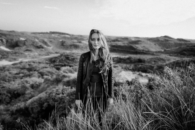 Fine art portrait of girl in dunes