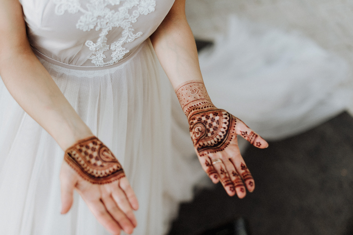 Hands of bride with beautiful henna