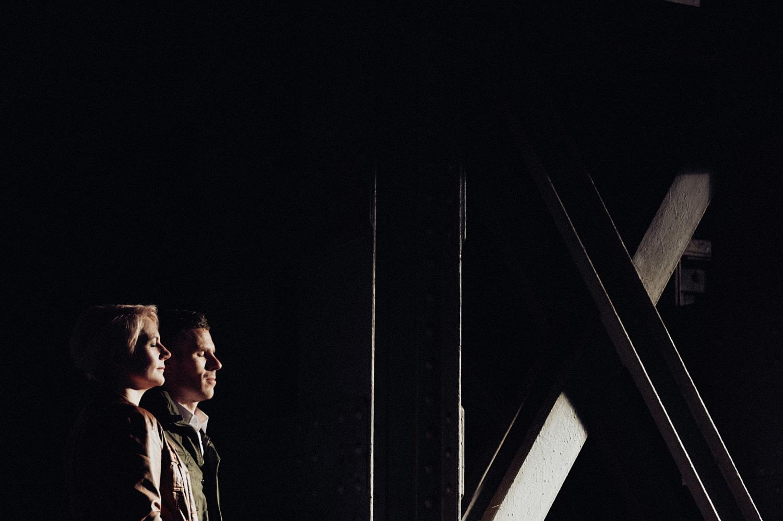 Couple in dark facing the light