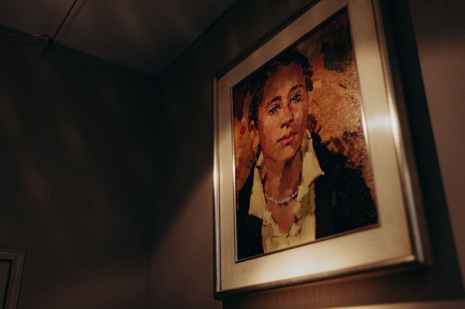 Painting of woman hanging on wall