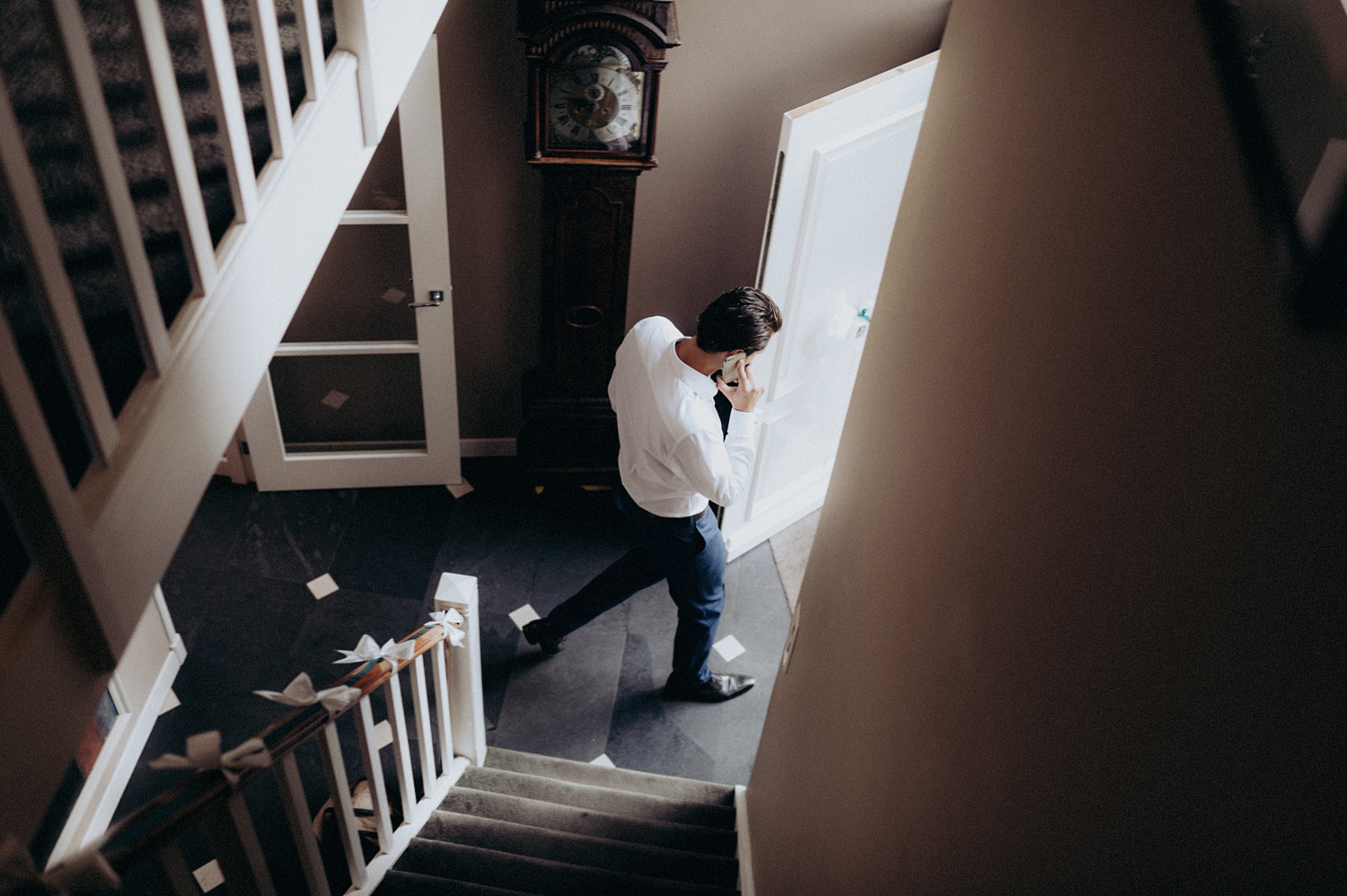 Guy on the phone down the stairs