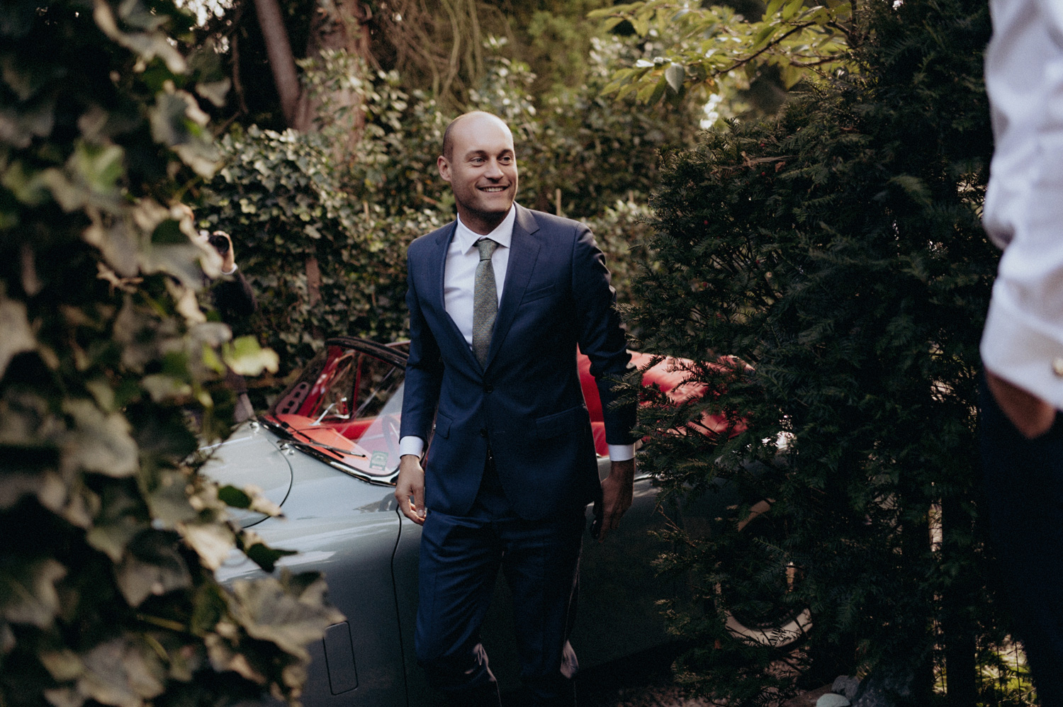 Groom arriving at parents house of bride